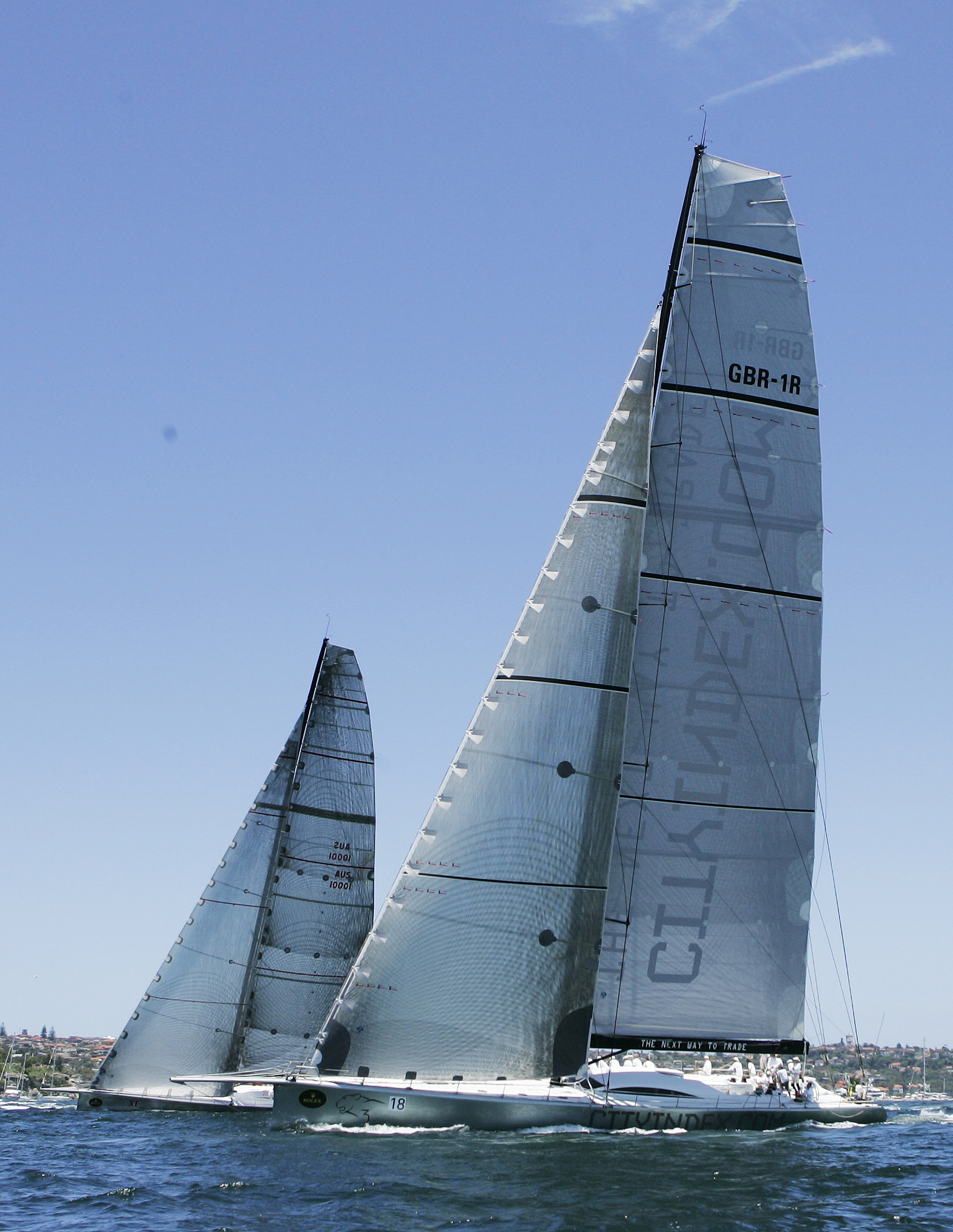 Wild Oats XI, left, leads Leopard at the start of the Sydney To Hobart yacht race in Sydney, Australia yesterday.