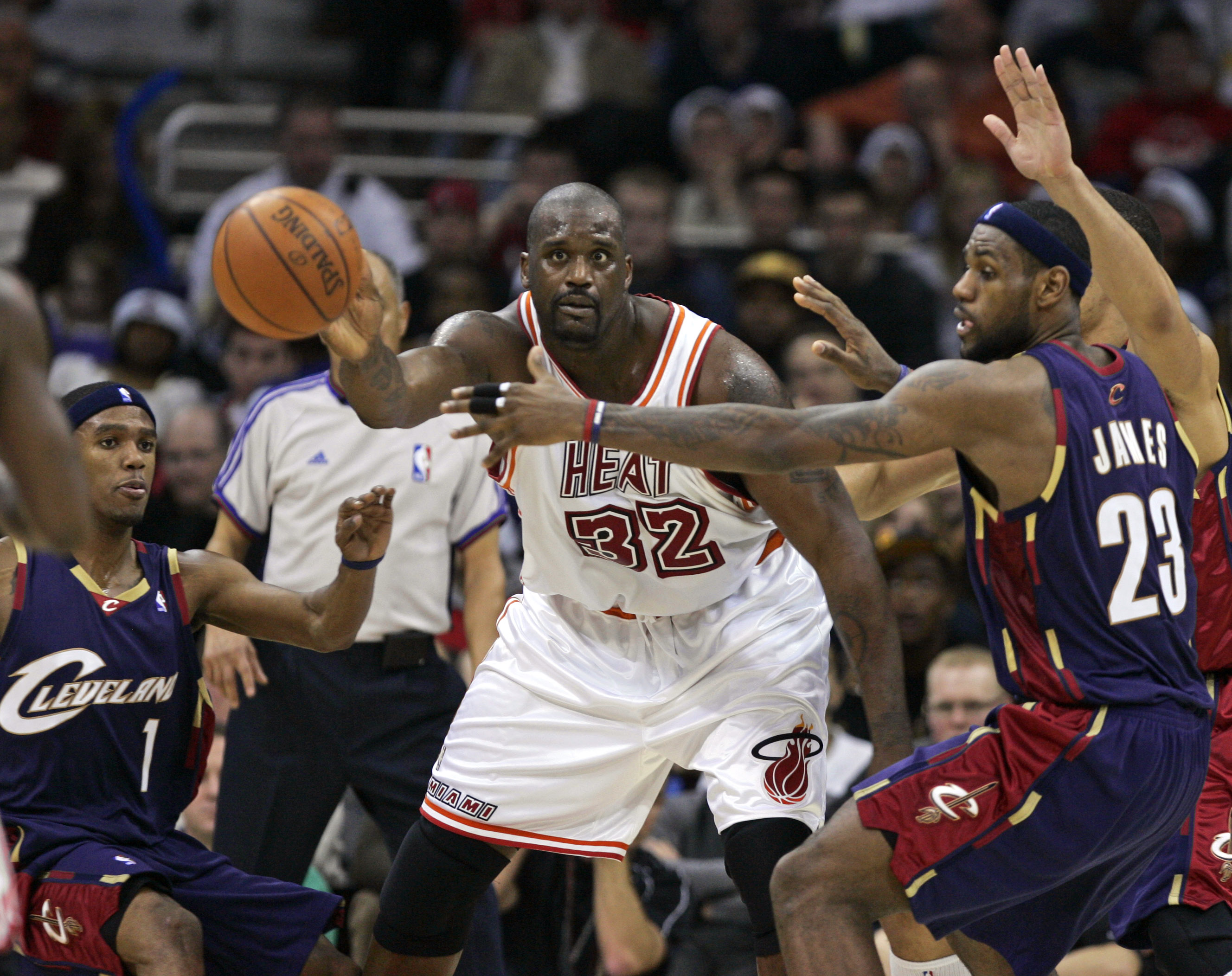 Miami Heat's Shaquille O'Neal (32) passes away from Cleveland Cavaliers' LeBron James (23) and Daniel Gibson during their NBA basketball game on Tuesd...