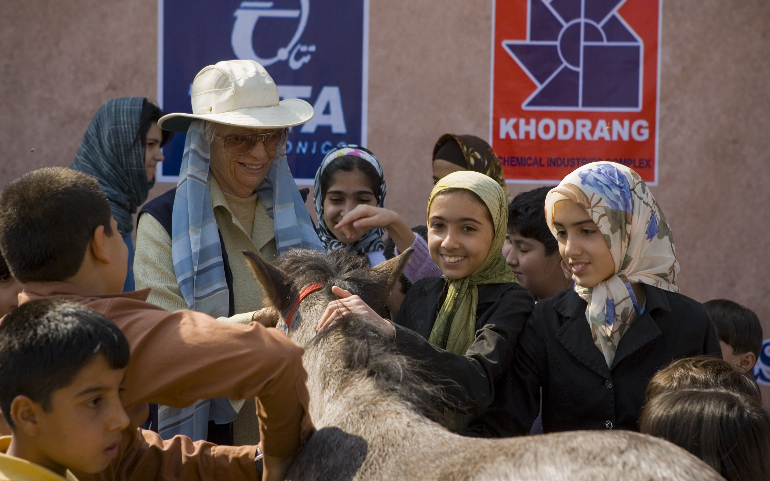 Louise Firouz is surrounded by children hoping to win a Caspian pony as a prize for the best horse drawing at a horse show in Isfahan, 450 kilometers ...
