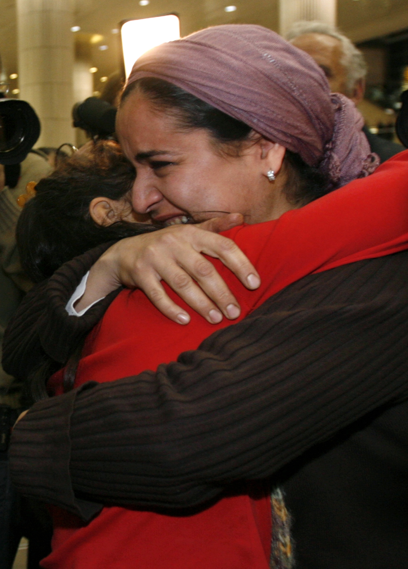 A newly arrived immigrant from Iran is hugged by a relative, right, at Ben Gurion International Airport near Tel Aviv December 25.
