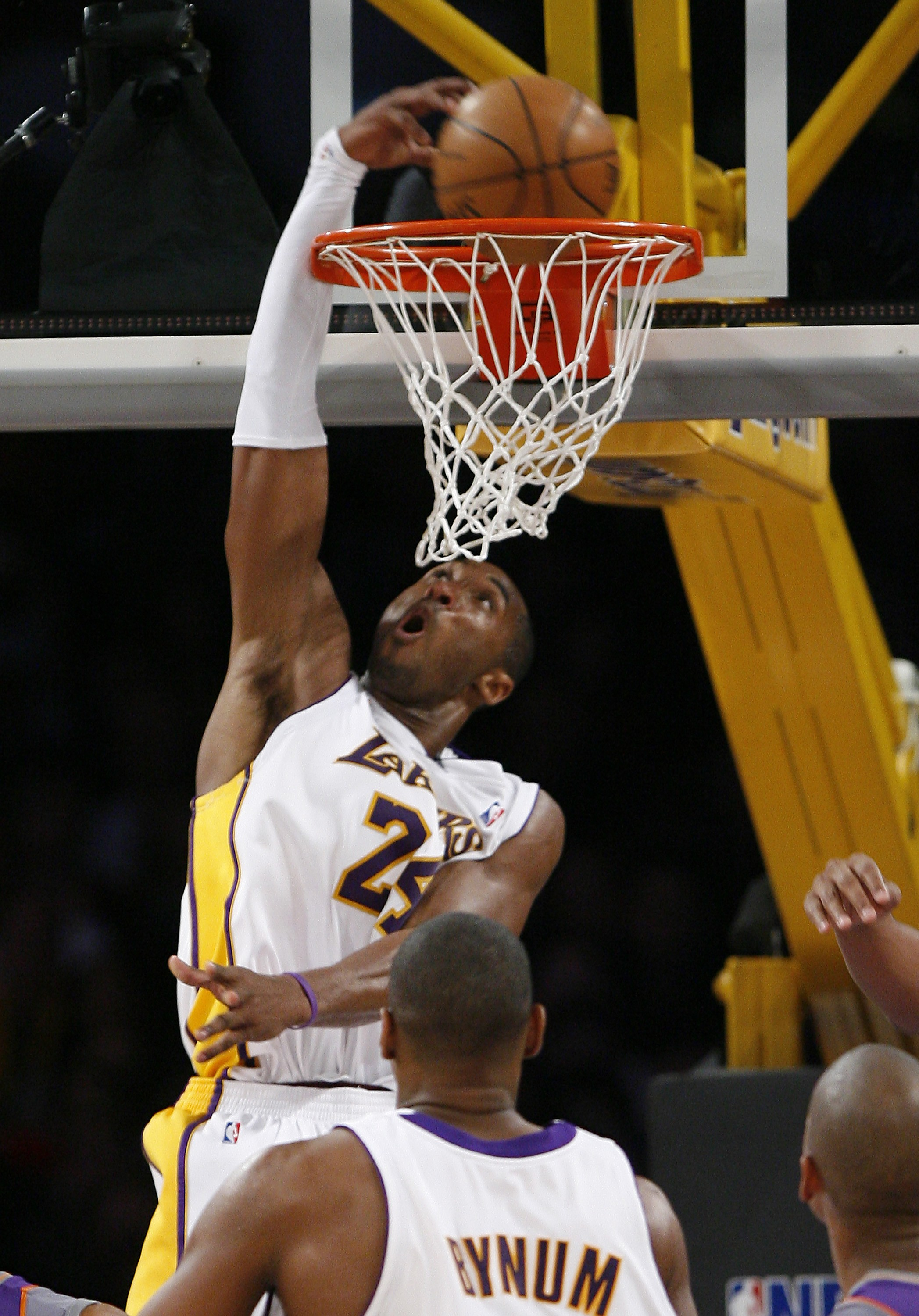 Los Angeles Lakers' Kobe Bryant dunks in the second half of the NBA basketball game against the Phoenix Suns on Tuesday in Los Angeles, California.