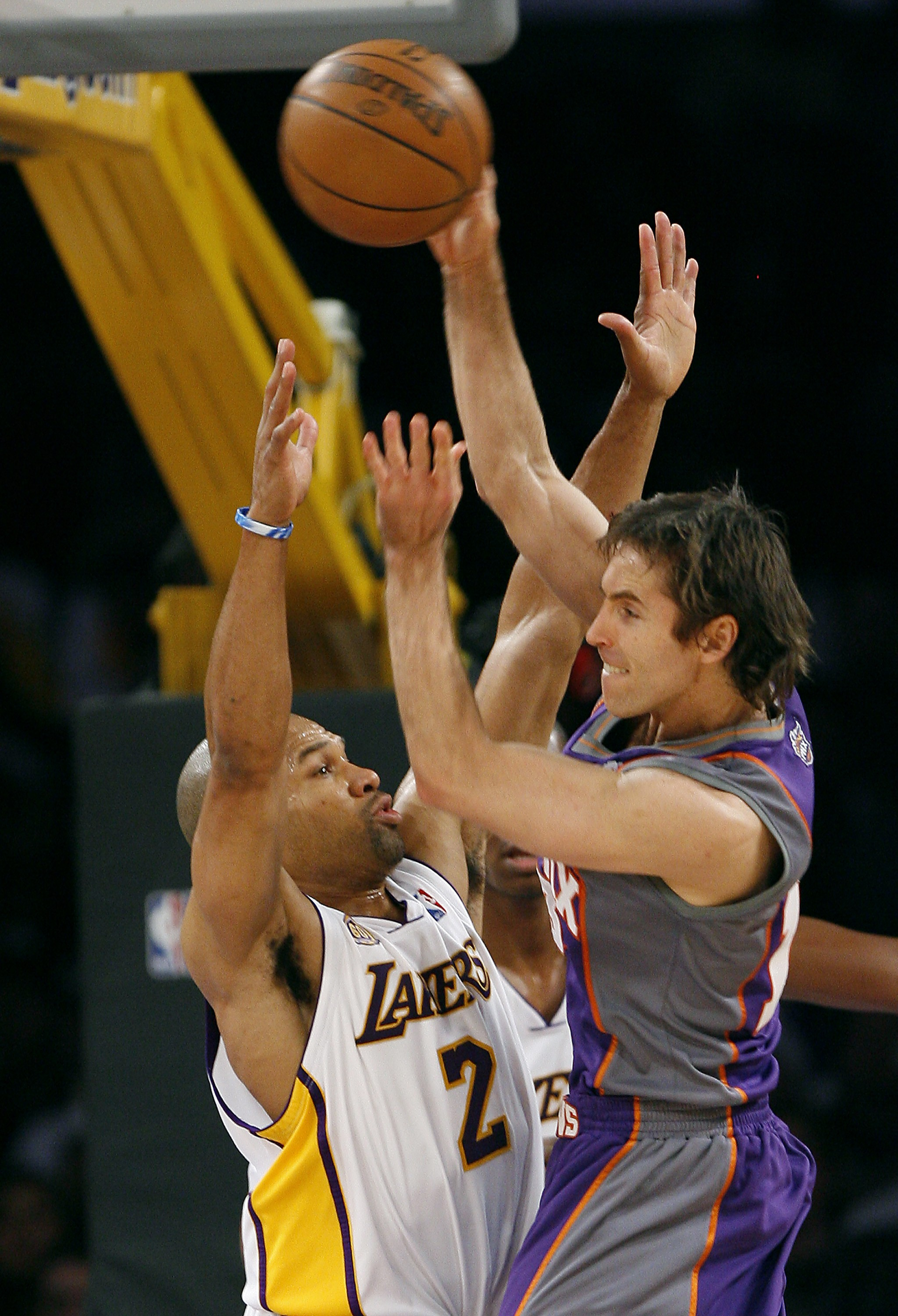 Phoenix Sun's Steve Nash, right, makes a cross-court pass over Los Angeles Lakers' Derek Fisher (2) in the first half of their NBA basketball game on ...