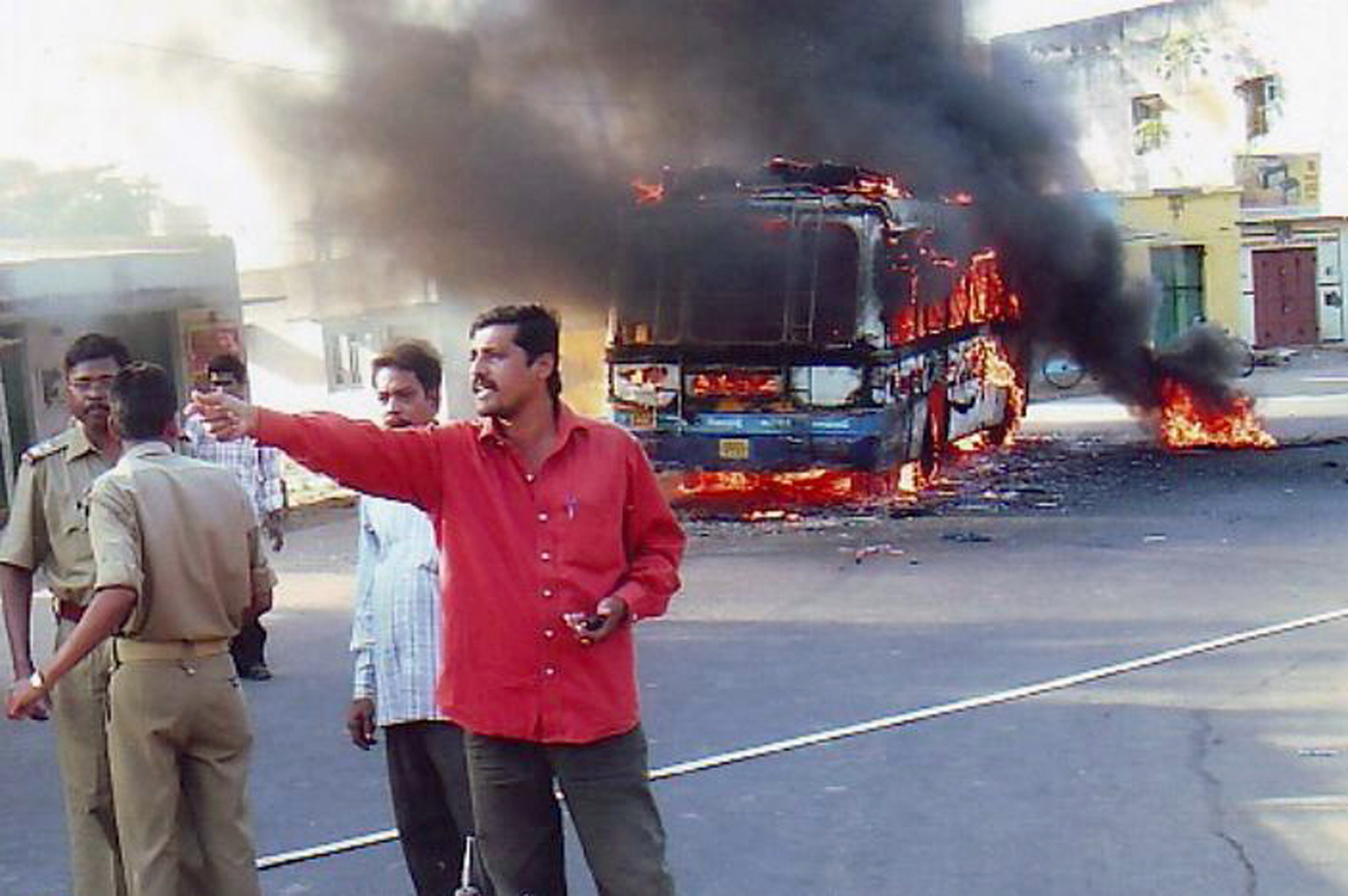 A bus set on fire by protesters goes up in flames at Baliguda in Phulbani district in Orissa state, India on Wednesday.