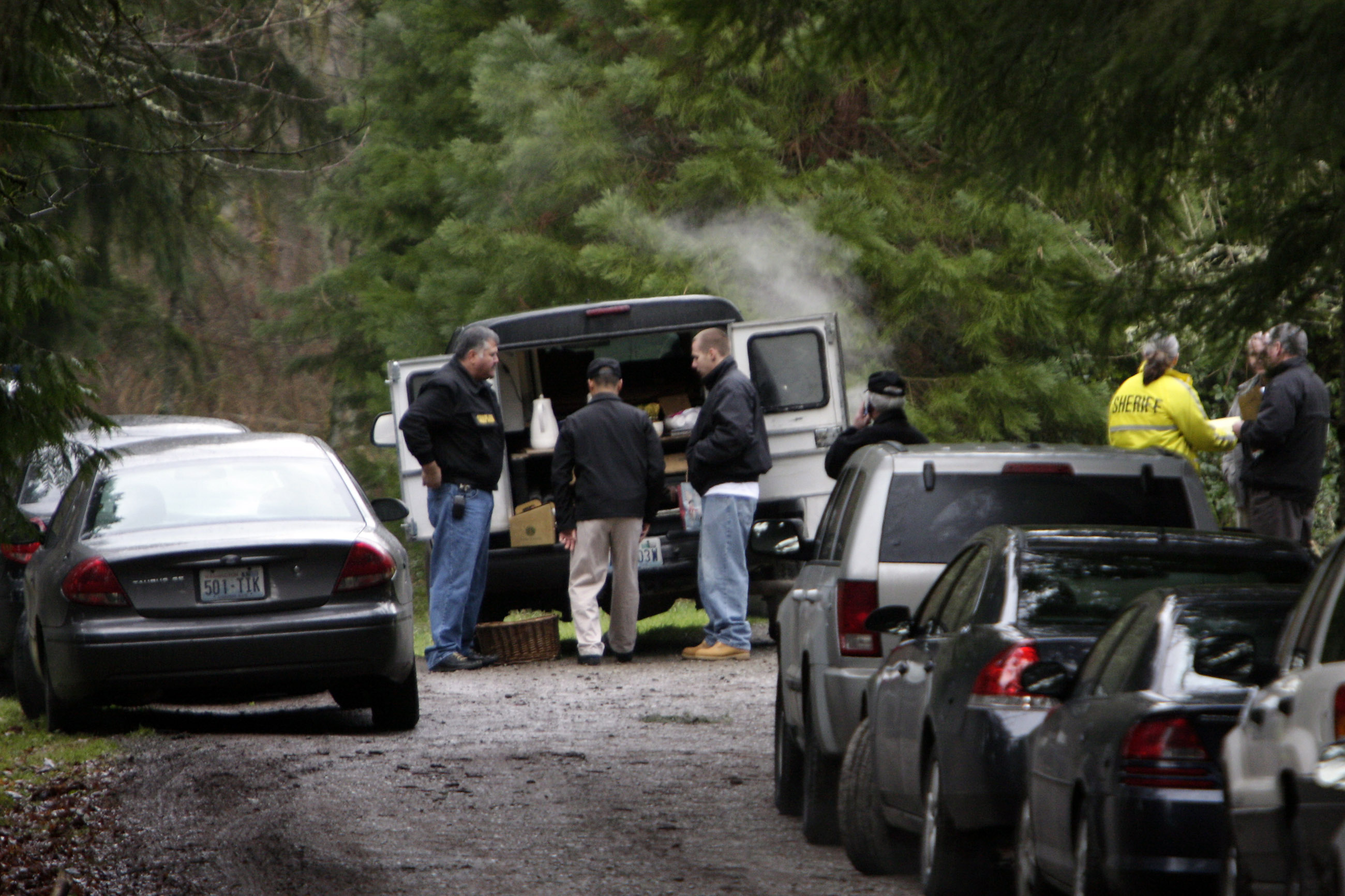 King County Sheriff detectives set up a command post near where the bodies of six people were found shot to death near Seattle, Washington on Wednesda...