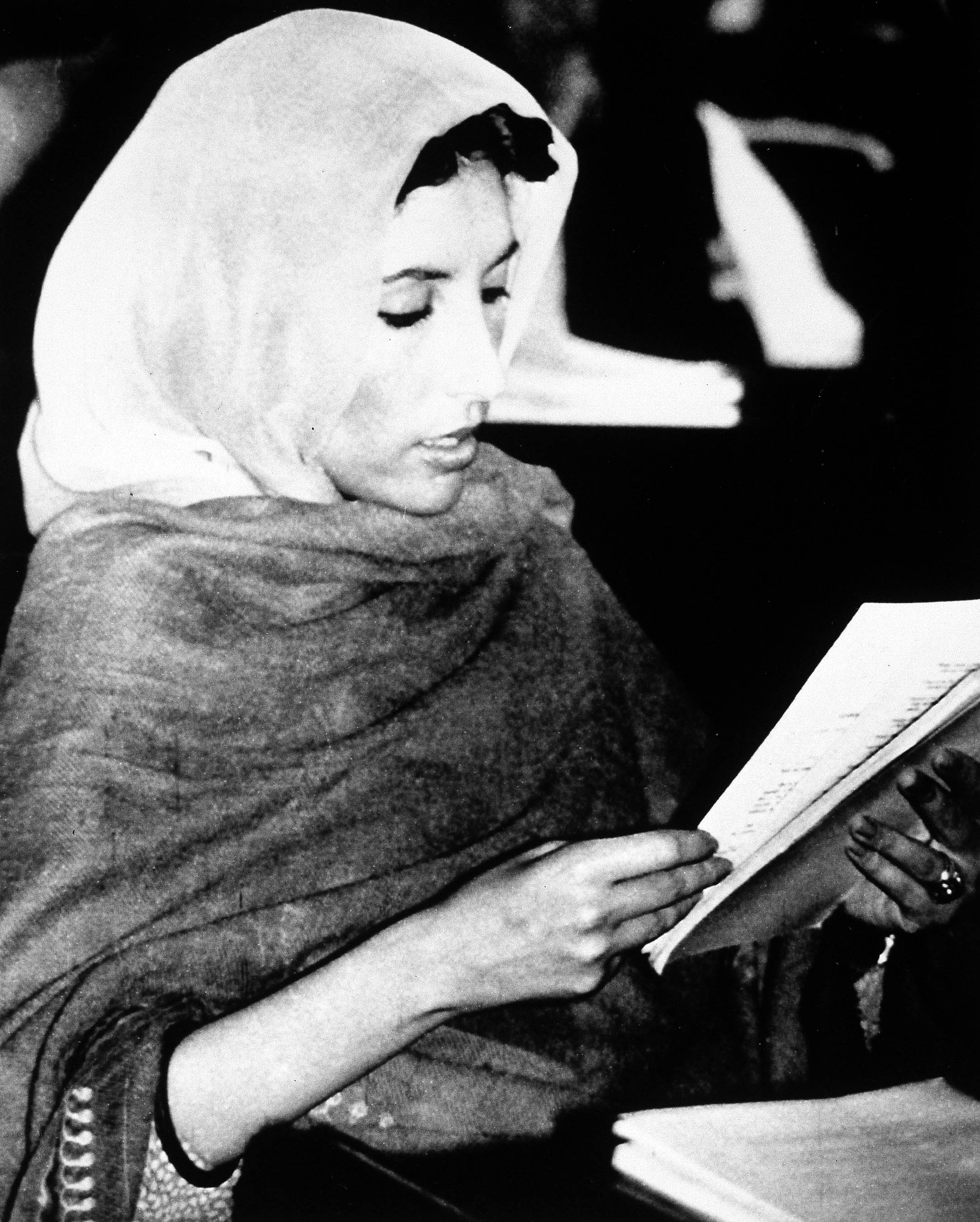 Then Pakistani Populist leader Benazir Bhutto is sworn in as a newly elected member of the national assembly, during a ceremony in Islamabad, Pakistan...