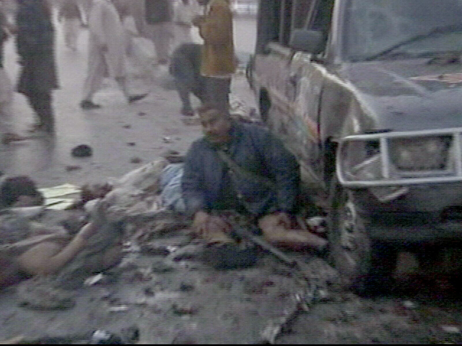 The aftermath of a suicide bombing is seen yesterday in Rawalpindi, Pakistan in this image taken from APTN.