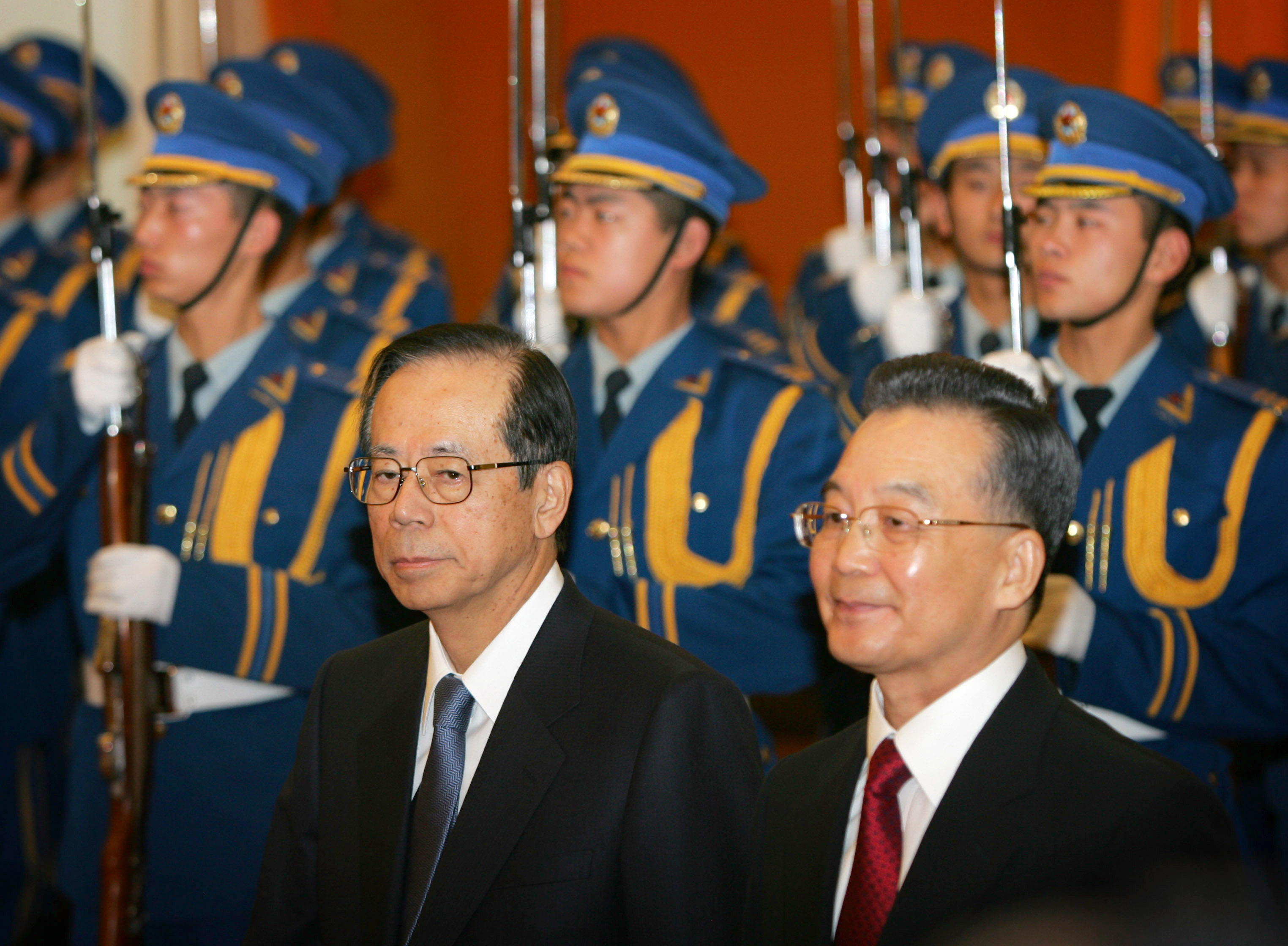 Japanese Prime Minister Yasuo Fukuda, left, and Chinese Premier Wen Jiabao review a guard of honor during a welcoming ceremony at the Great Hall of th...