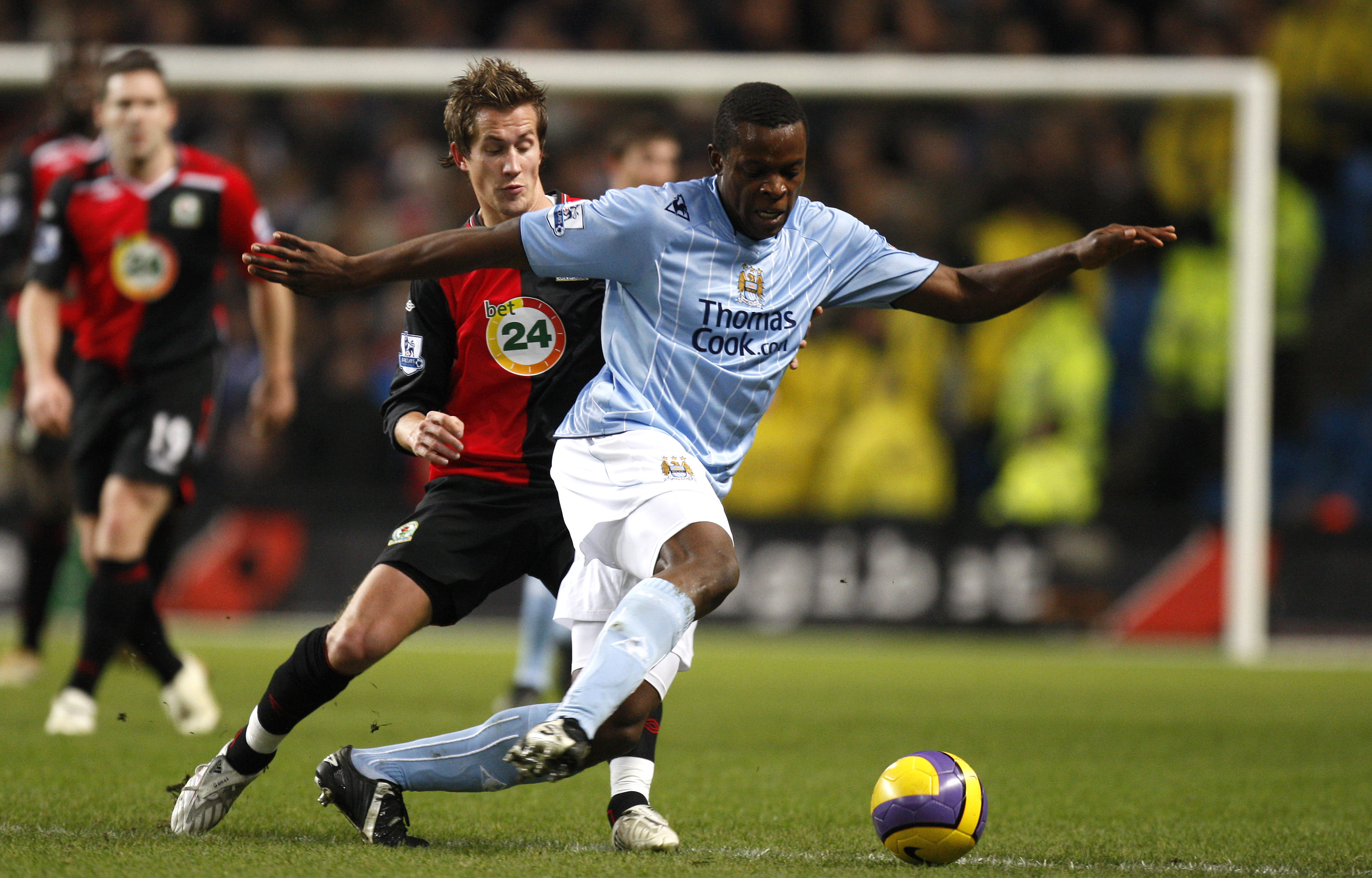 Machester City's Nedum Onuoha, right, keeps the ball from Blackburn's Morten Gamst Pedersen during their English Premier League soccer match at The Ci...
