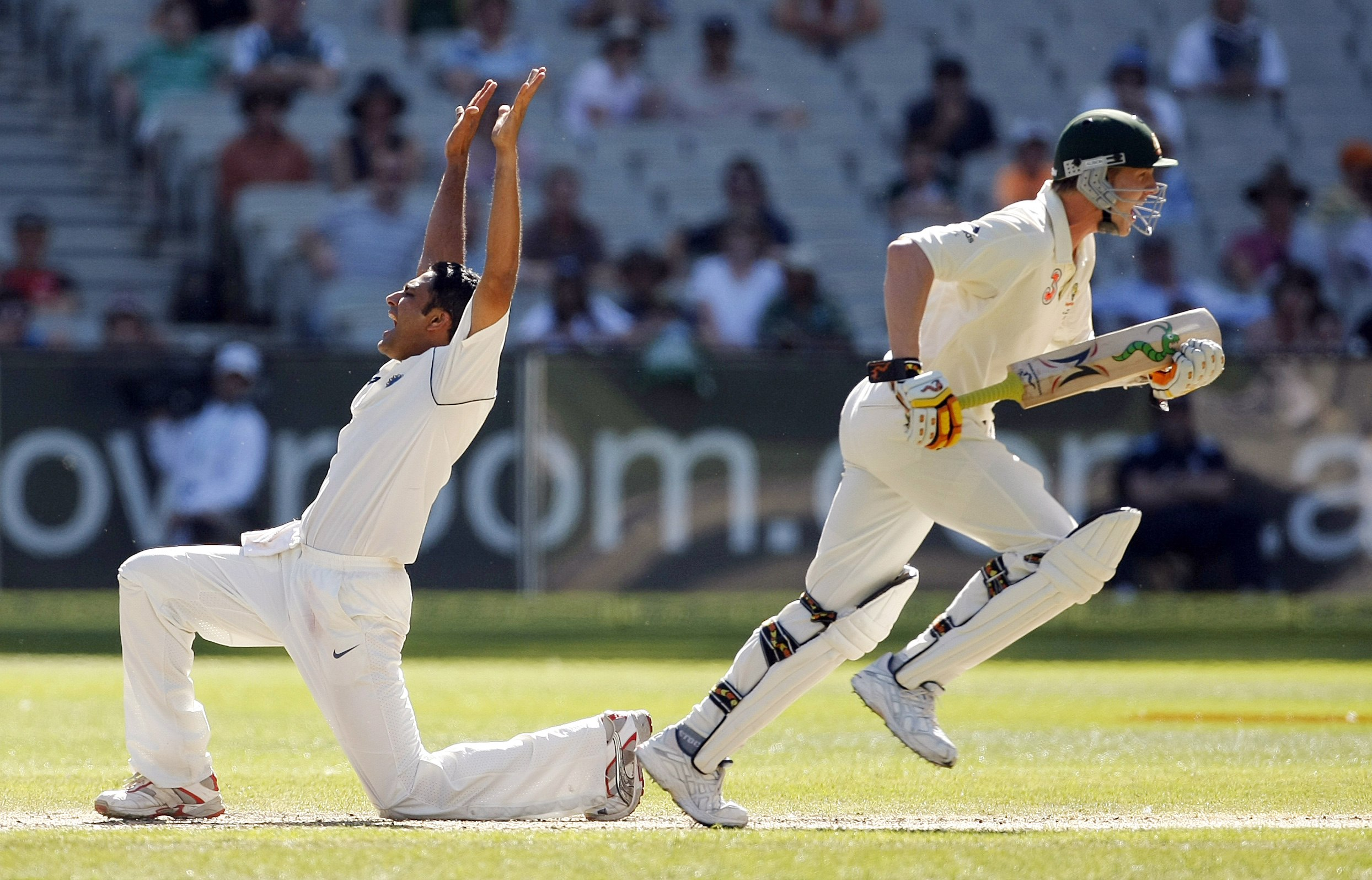 India's captain Anil Kumble, left, makes an unsuccessful appeal as Australia's Brett Lee runs past during the third day's play of their first test cr...