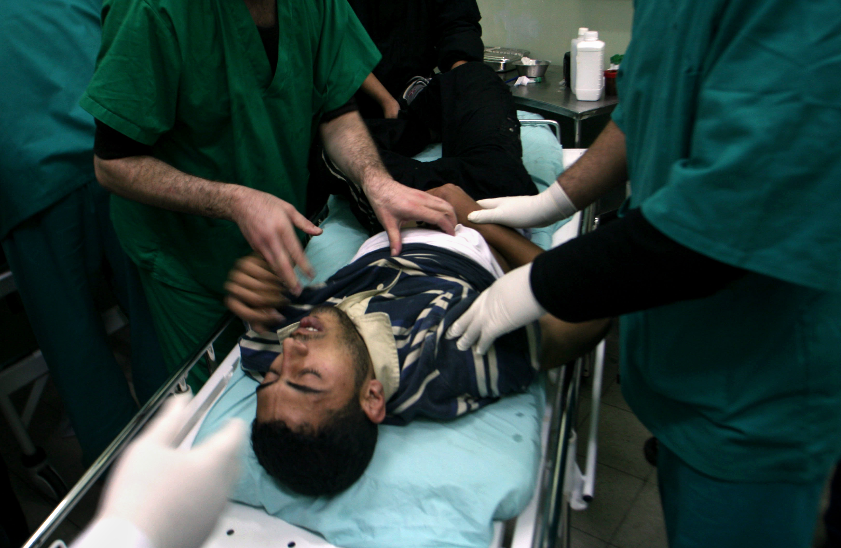 Palestinian medics treat a wounded man at Nasser Hospital in the Southern Gaza Strip on Thursday.