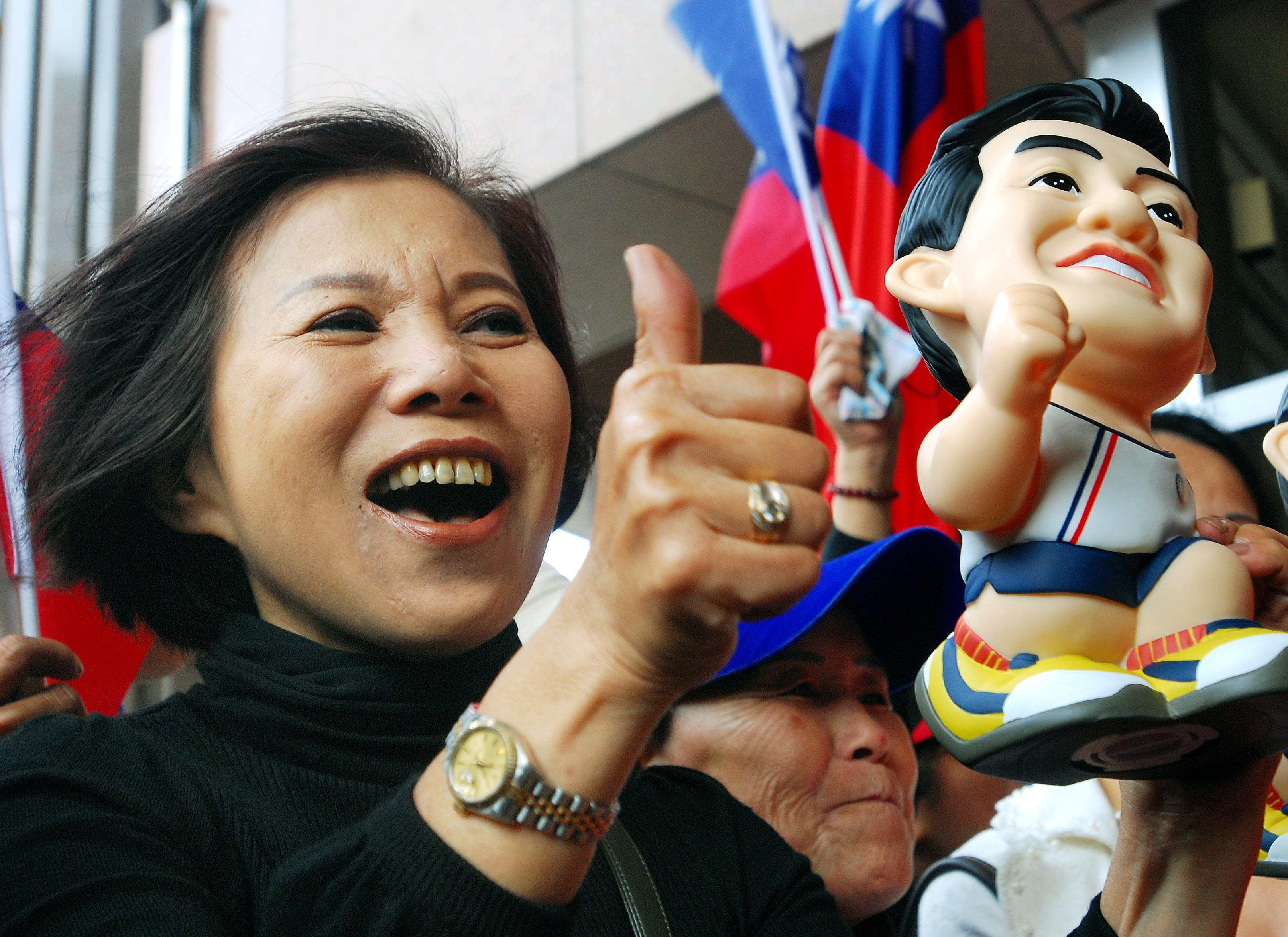 Supporters of opposition presidential candidate Ma Ying-jeou celebrate outside Ma's office in Taipei yesterday.