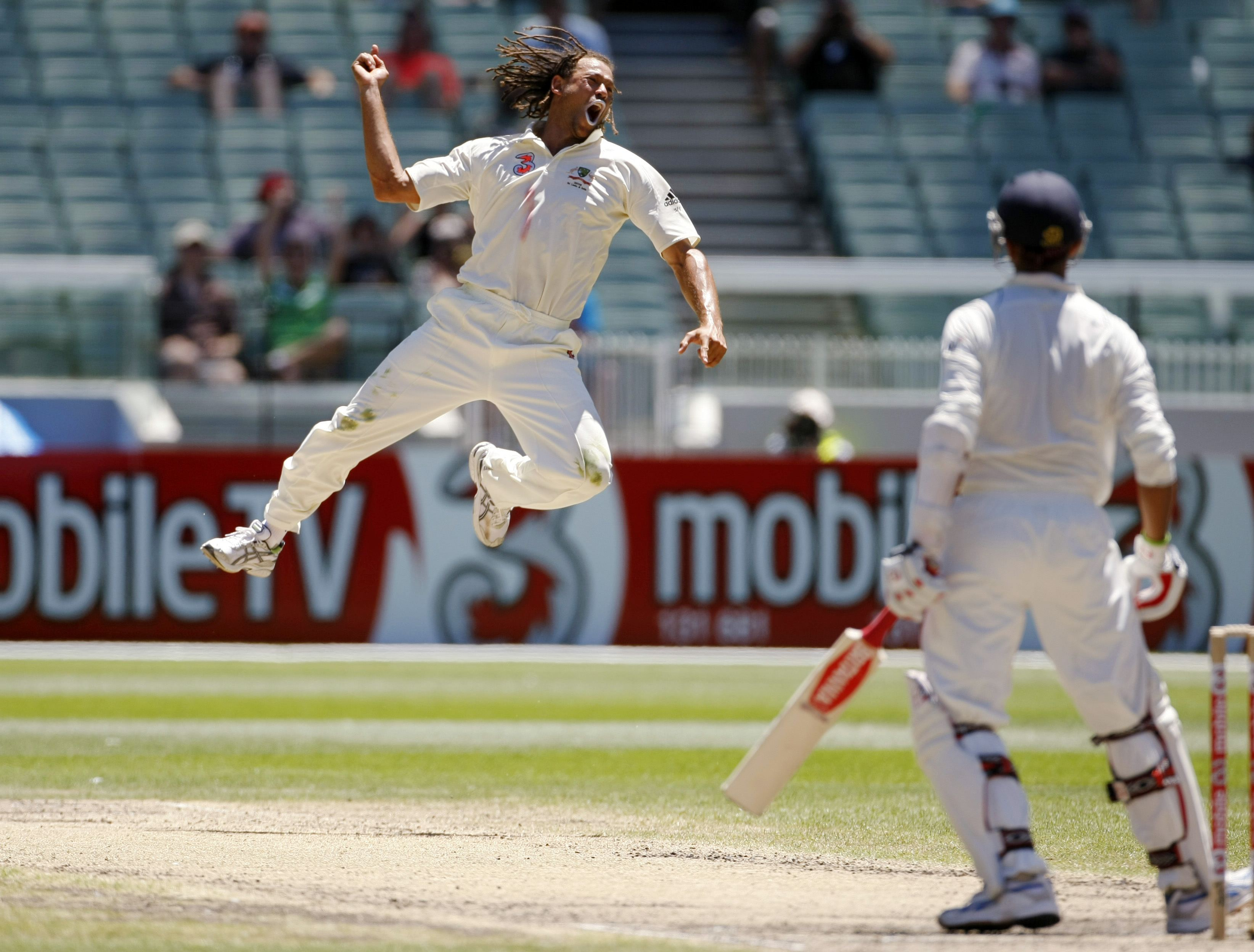 Australia's Andrew Symonds, left, reacts after dismissing India's Rahul Dravid, right, during the fourth day's play of the first test cricket match in...