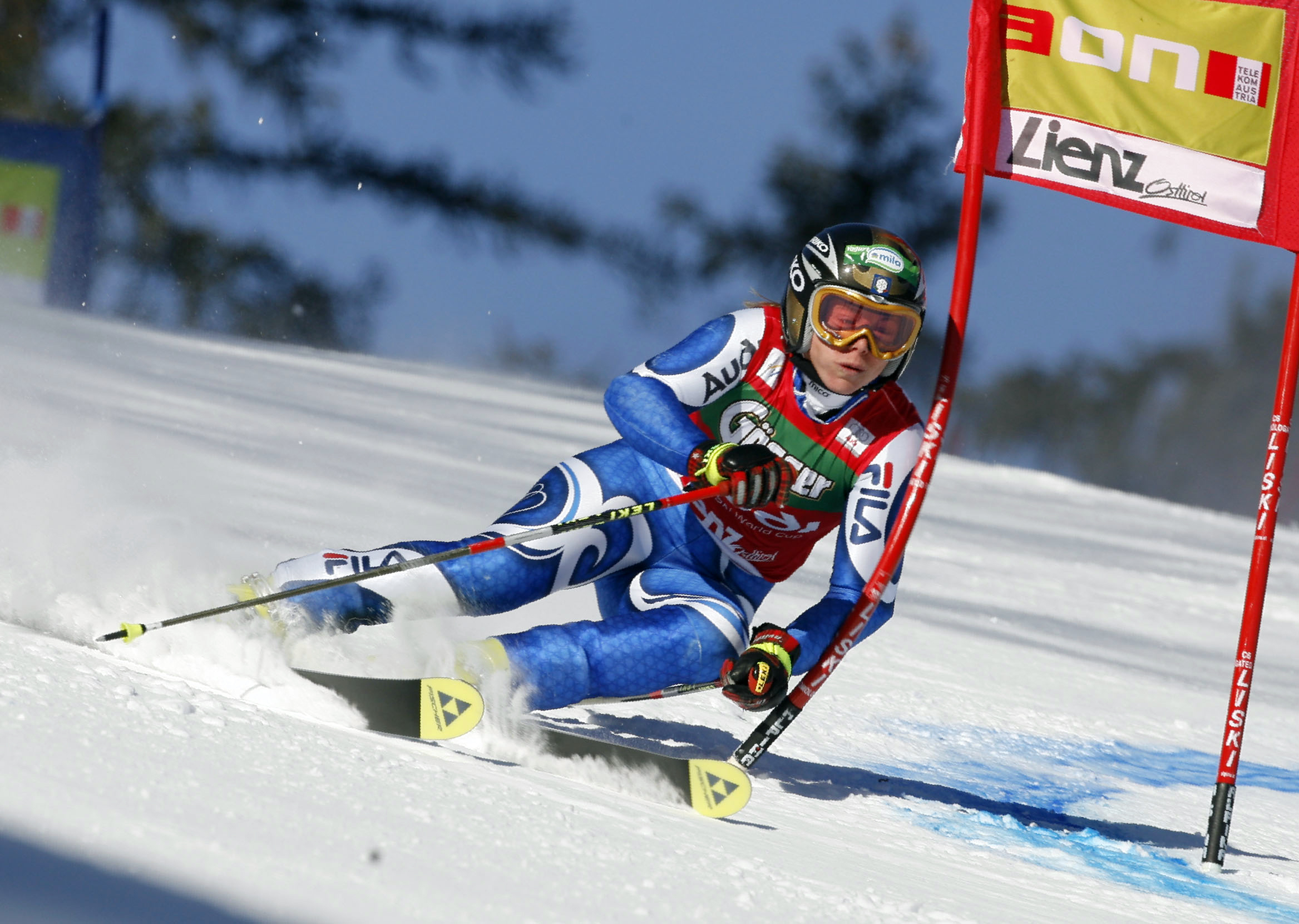 Denise Karbon, of Italy, passes a gate on her way to setting the fastest time during the first run of an alpine ski, women's World Cup giant slalom ra...