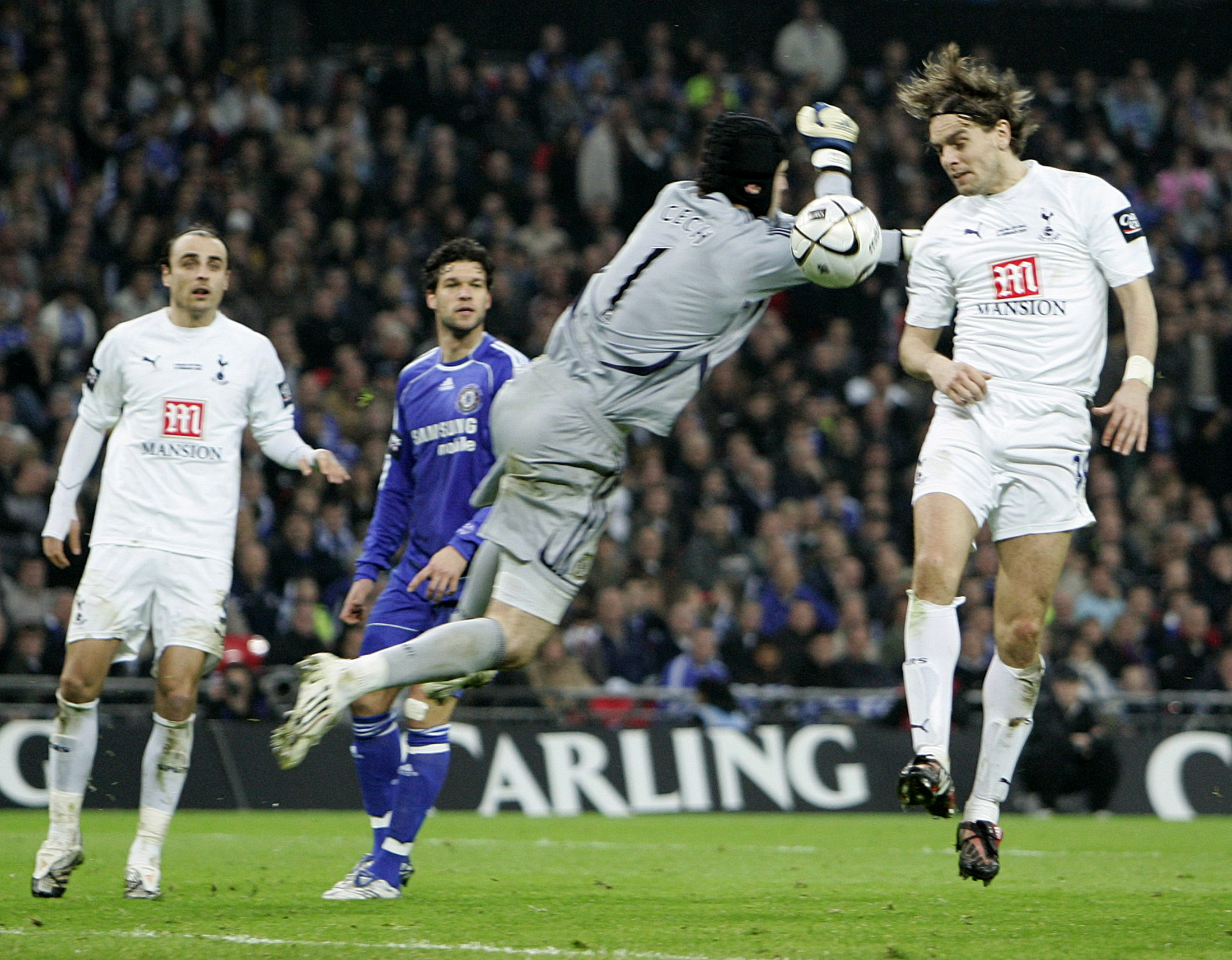 Tottenham Hotspur's Jonathan Woodgate, right, scores past Chelsea's Petr Cech during their Carling Cup final soccer match at Wembley Stadium in London...
