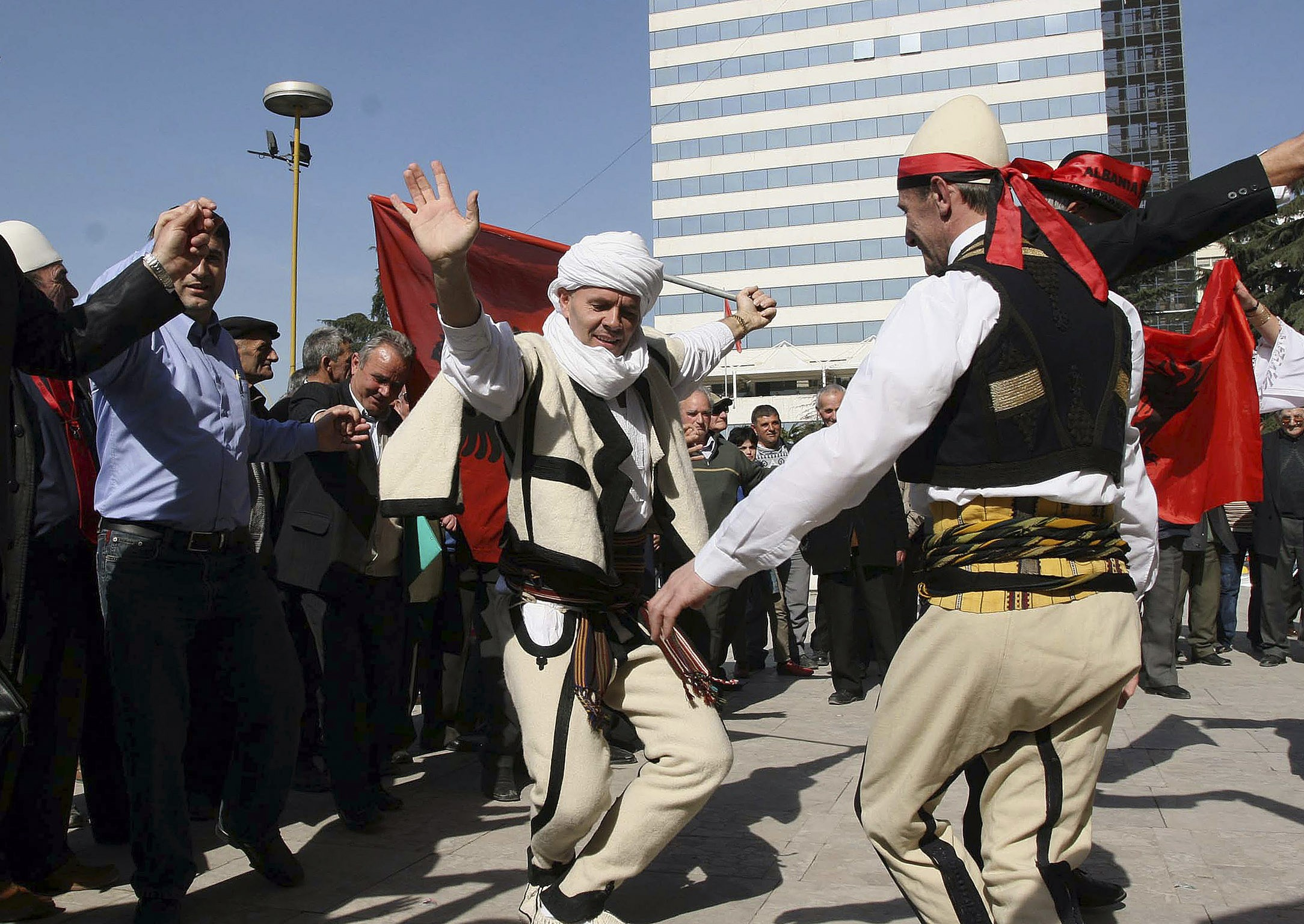 Albanian Kosovo immigrants dance in celebration in Tirana's main square on Monday to hail the recent declaration of independence of Kosovo. The group ...