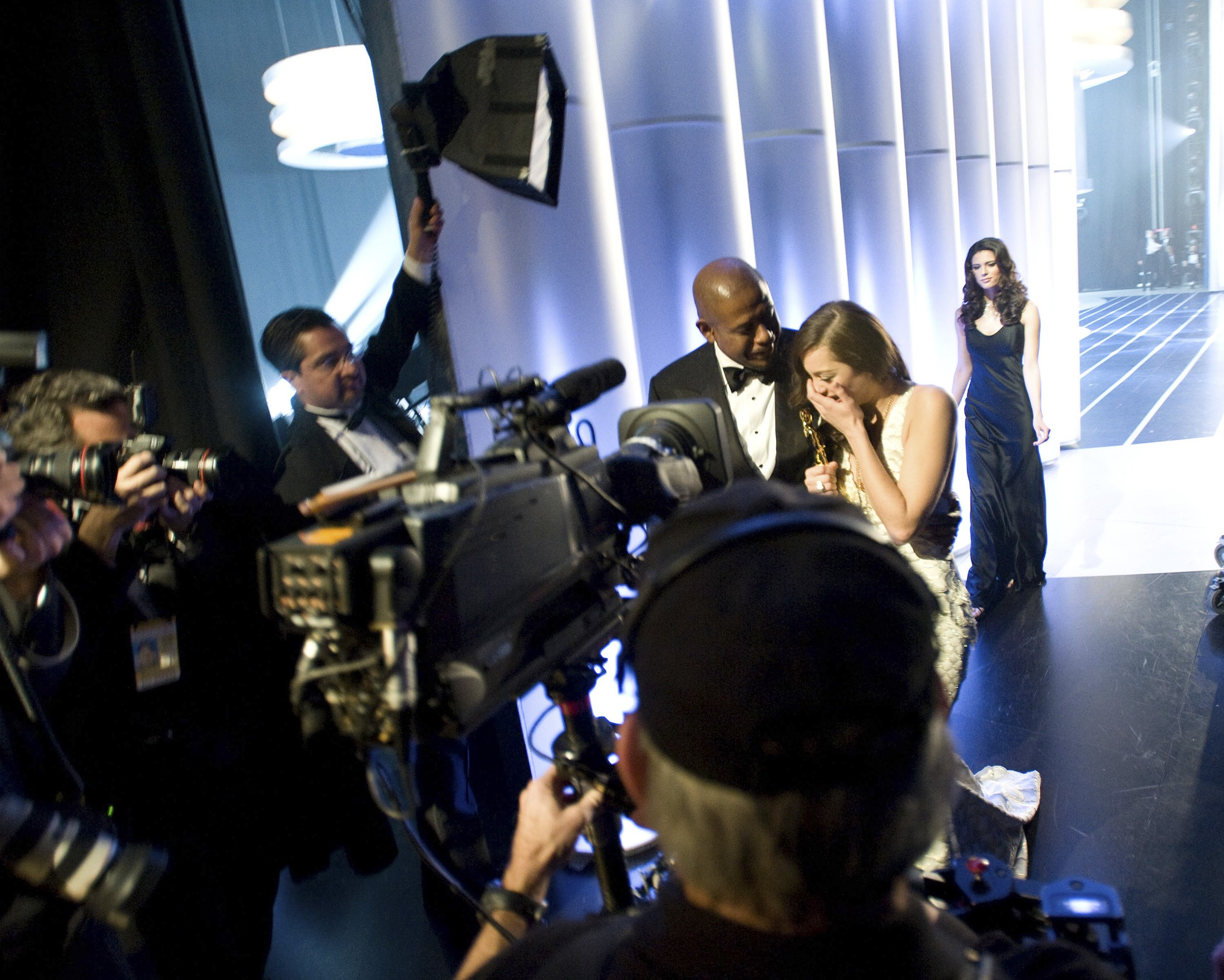 Best Actress winner Marion Cotillard, right, with presenter Forest Whitaker are seen backstage during the Sunday's Academy Awards in Hollywood, Califo...