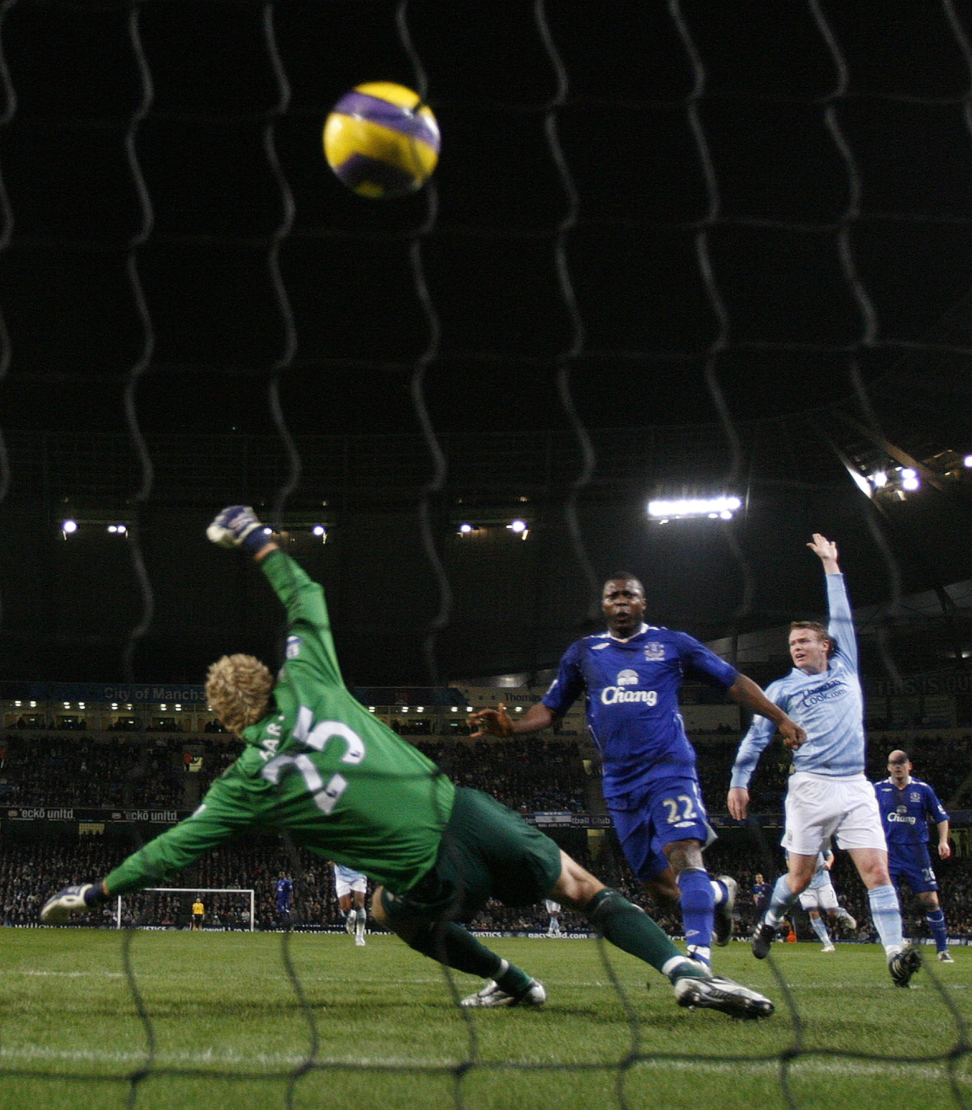 Everton's Ayegbeni Yakudu, center, scores past Manchester City's Joe Hart, left, during their English Premier League soccer match at the City of Manch...