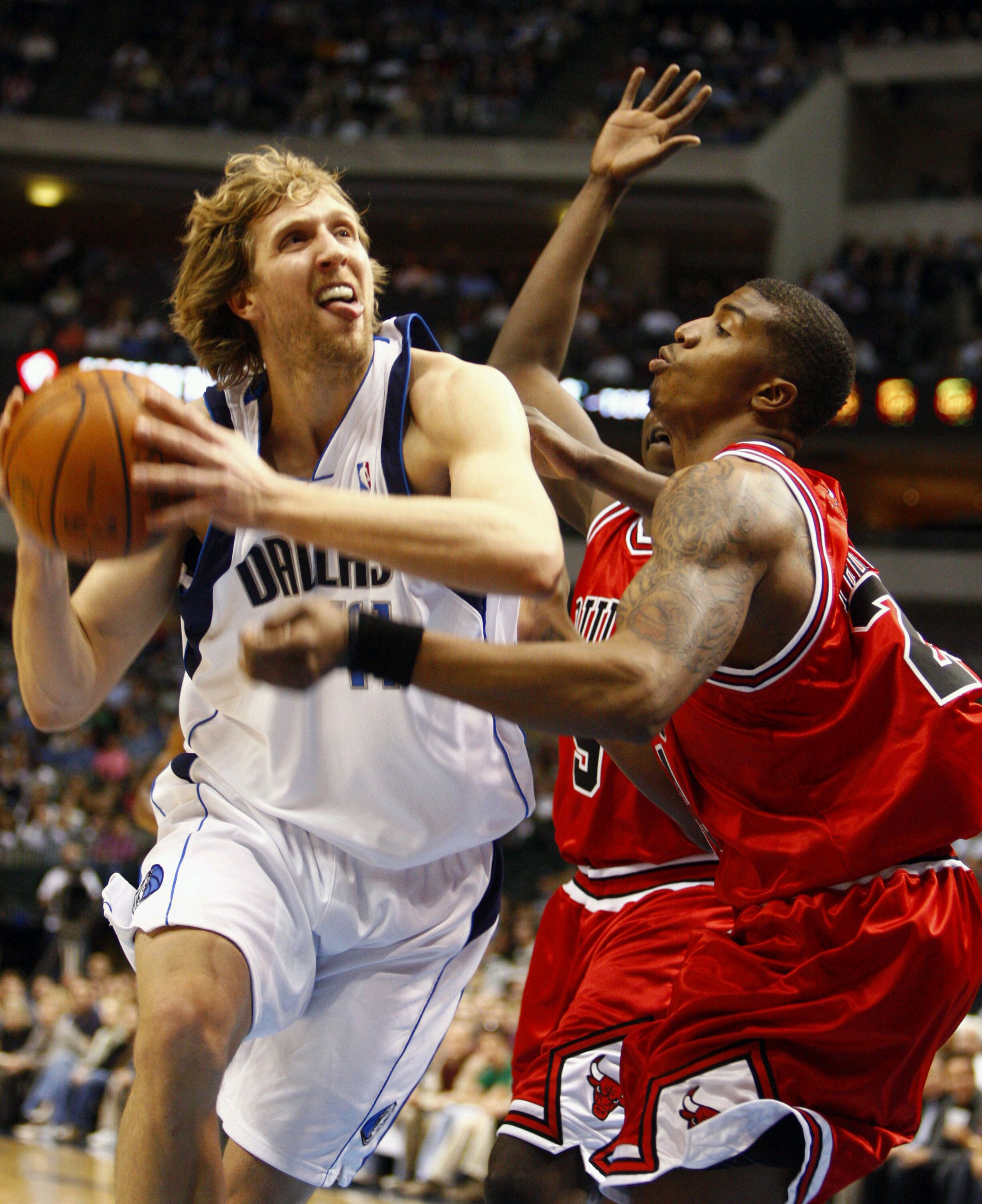 Dallas Mavericks forward Dirk Nowitzki, left, drives to the basket against Chicago Bulls Tyrus Thomas on Monday at the American Airlines Center in Dal...