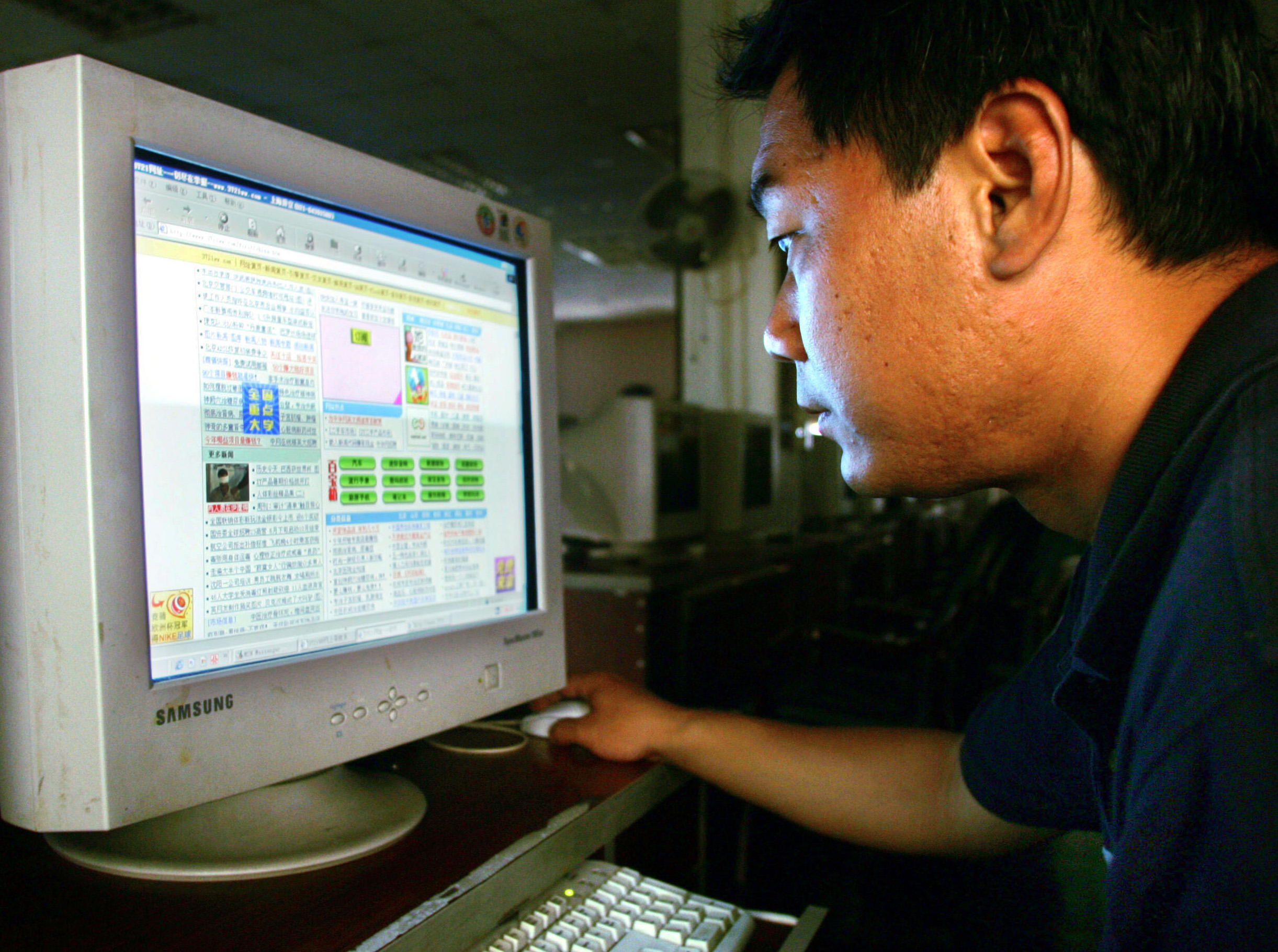 A young man browses a Web site at an Internet cafe in Shanghai, China, in this June 2004 file photo.