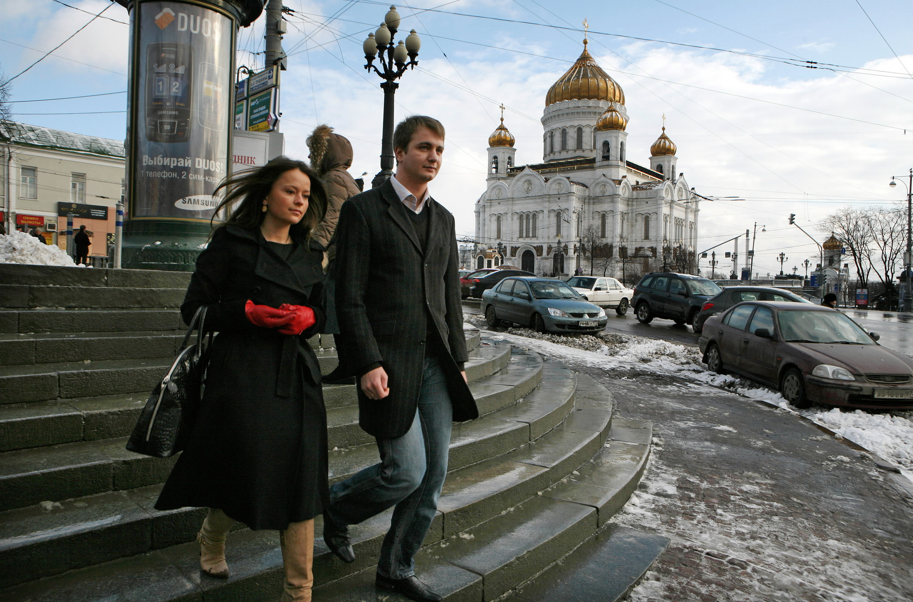 Kirill Shchitov walks past a Russian Orthodox church with his fiancee, Elena Filatova, in Moscow, Russia, in this undated photo. He is a believer and ...
