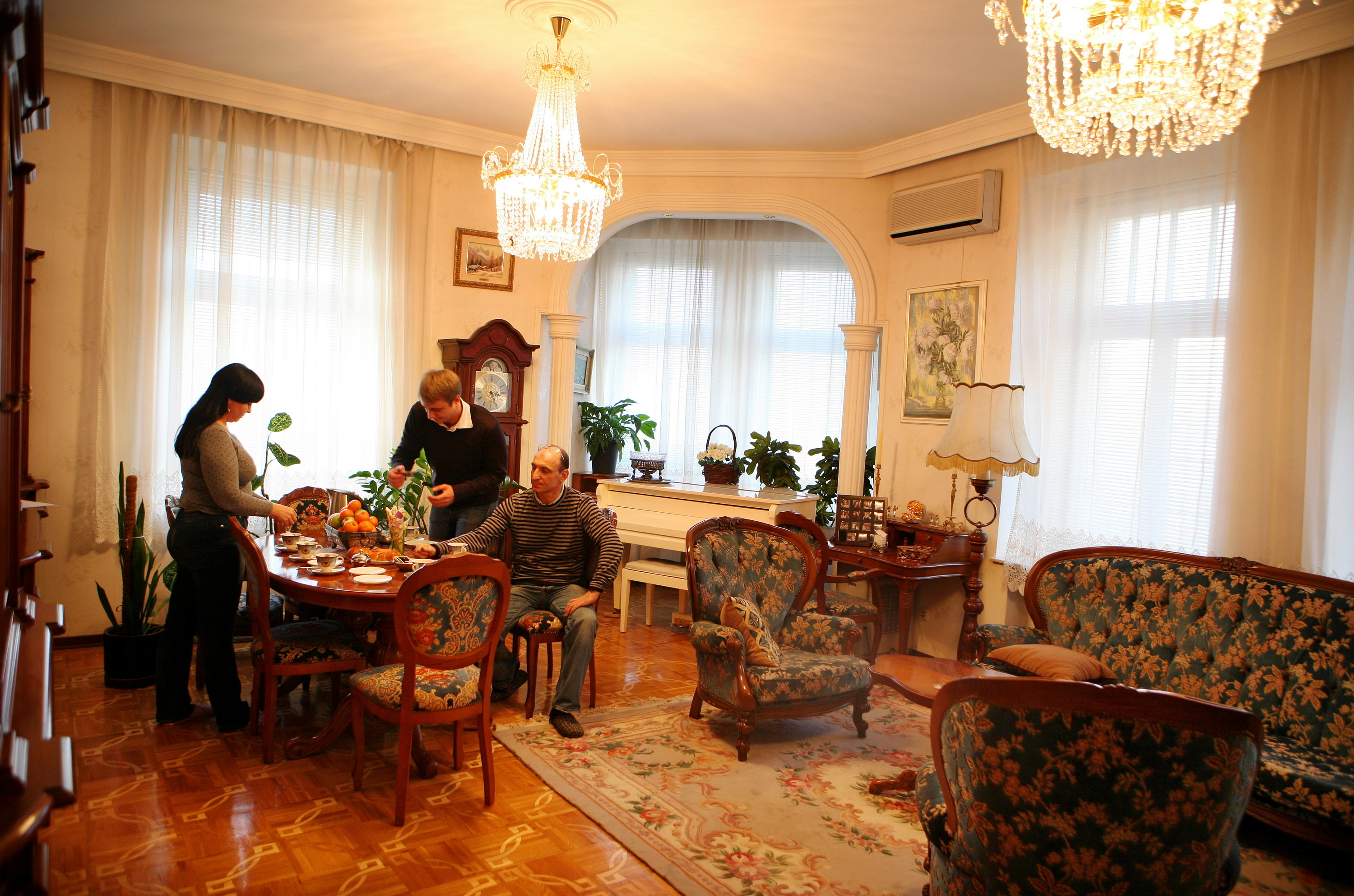 Kirill Shchitov and his parents, Vladimir and Alla, are seen having tea in their living room in Moscow, Russia, in this undated photo.