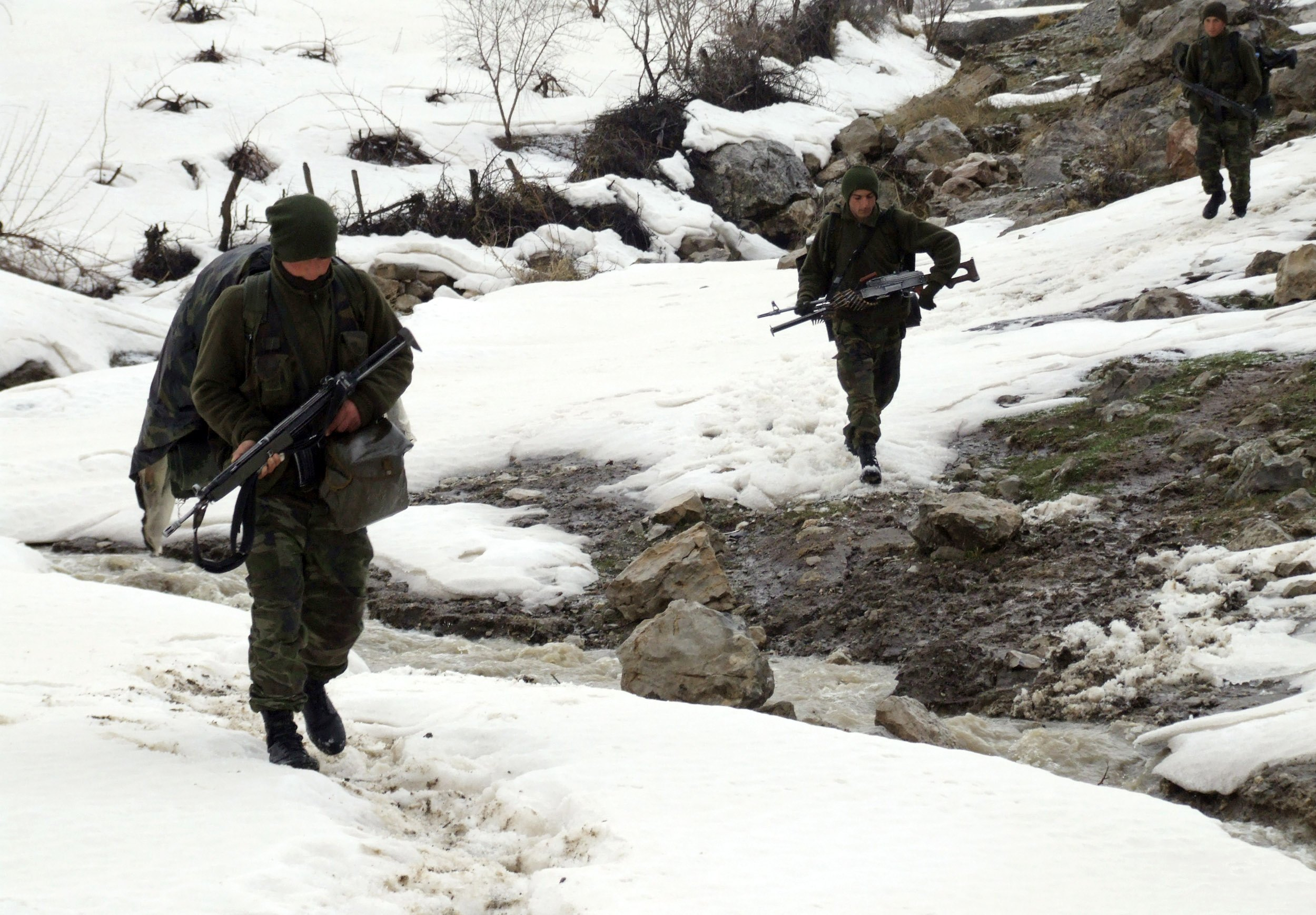 Turkish soldiers walk in a snow-covered area as they patrol in the southeastern Turkish province of Sirnak, bordering Iraq, on Tuesday.