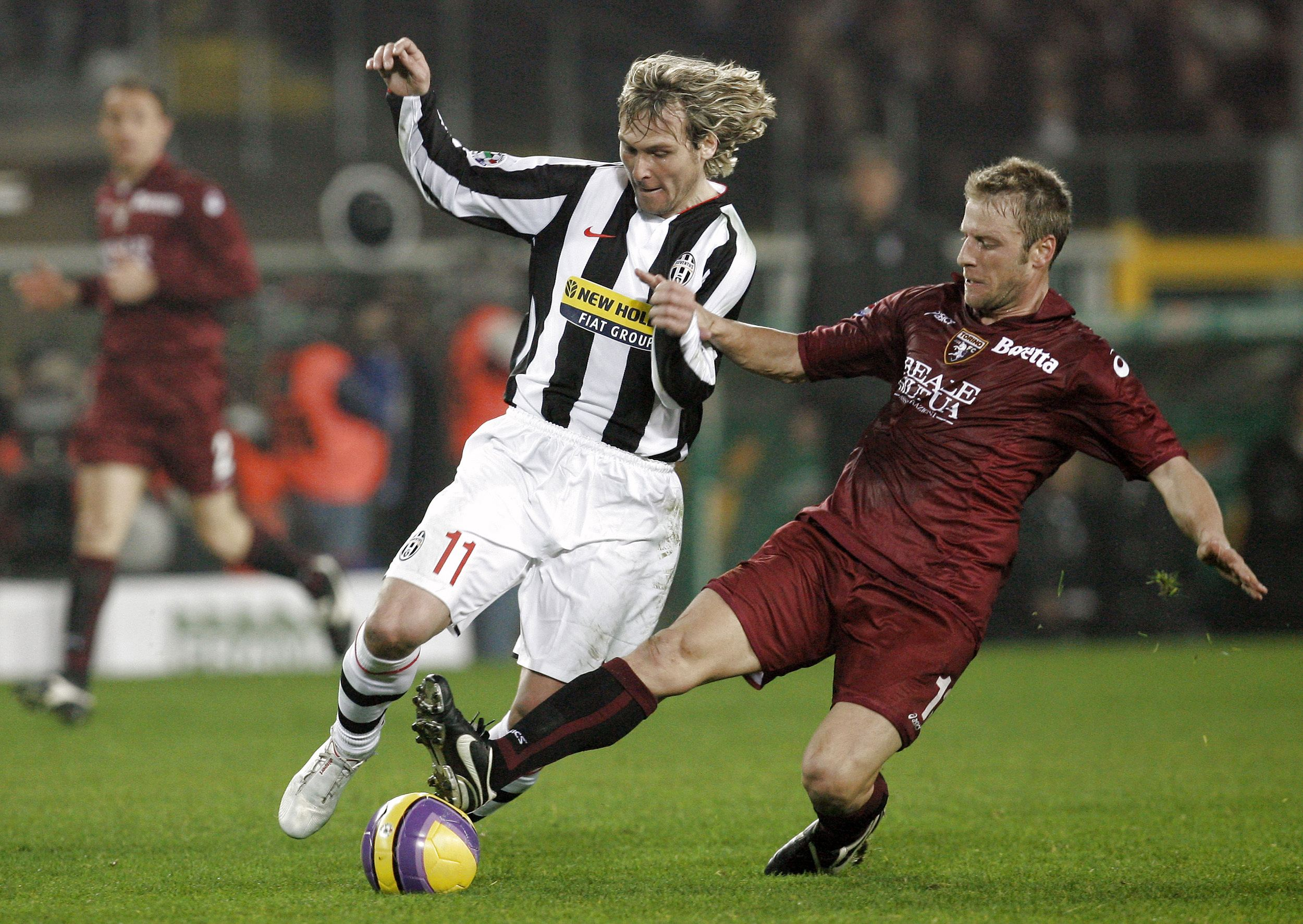 Juventus' Pavel Nedved, left, and Torino's Vincenzo Grella fight for the ball during their Italian Serie A soccer match in Turin, Italy on Tuesday.