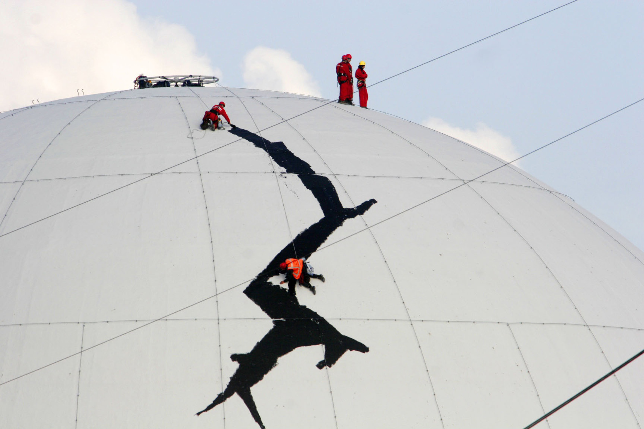 Greenpeace activists enter the Borssele nuclear plant to paint a huge crack on the plant's dome in Zeeland, the Netherlands, in this handout photo dat...