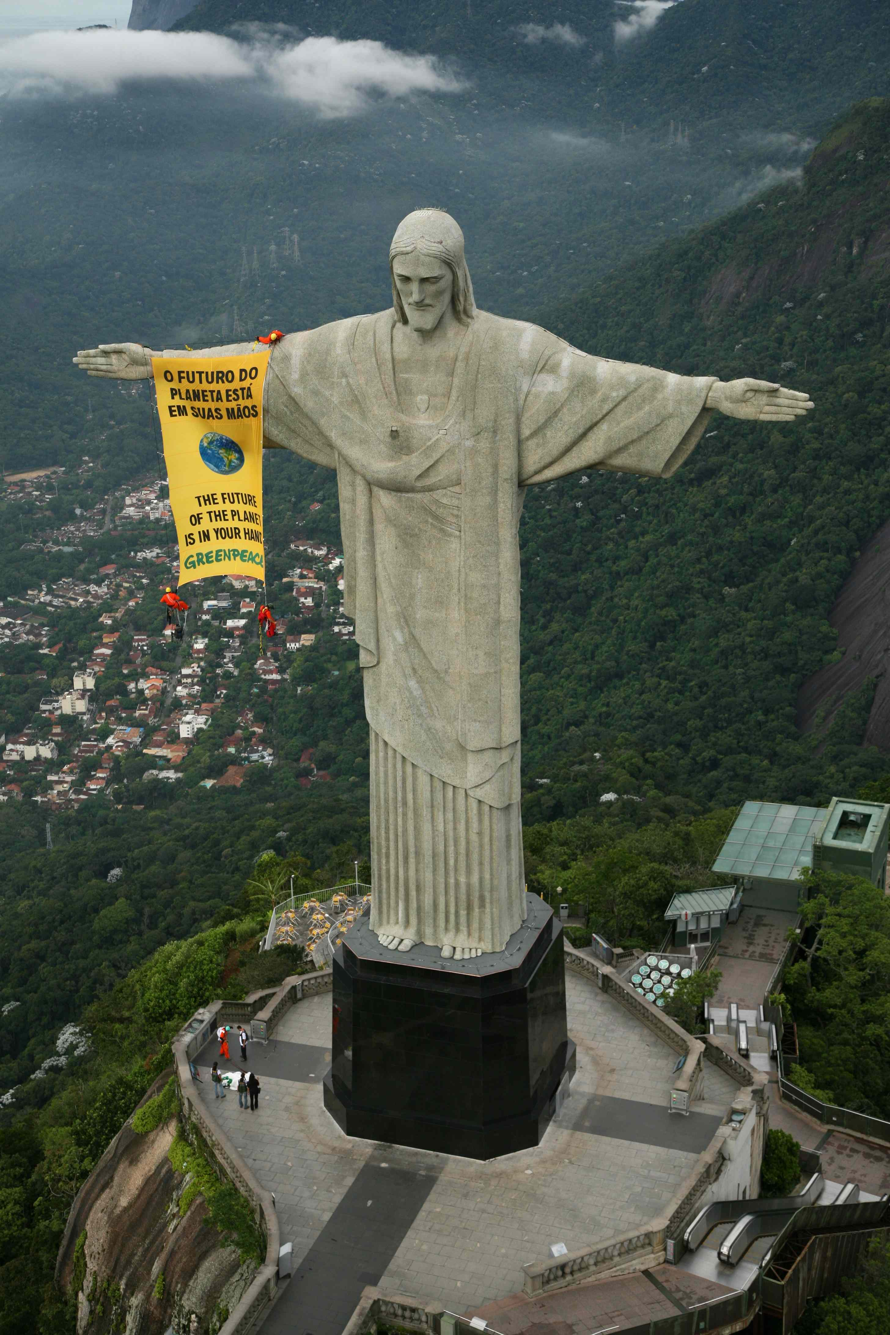 Greenpeace axtivists unfurl a banner from the Christ the Redeemer statue
