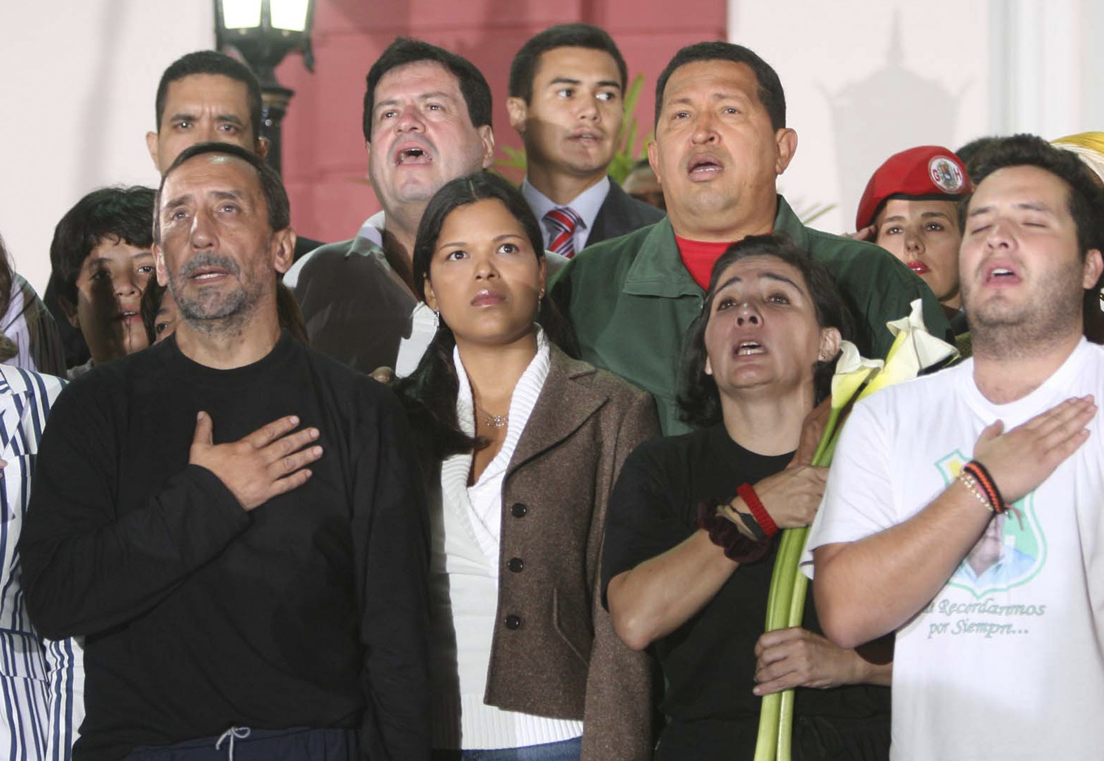 Venezuelan President Hugo Chavez, third from right, sings with the newly freed hostages in Caracas, Venezuela on Wednesday.