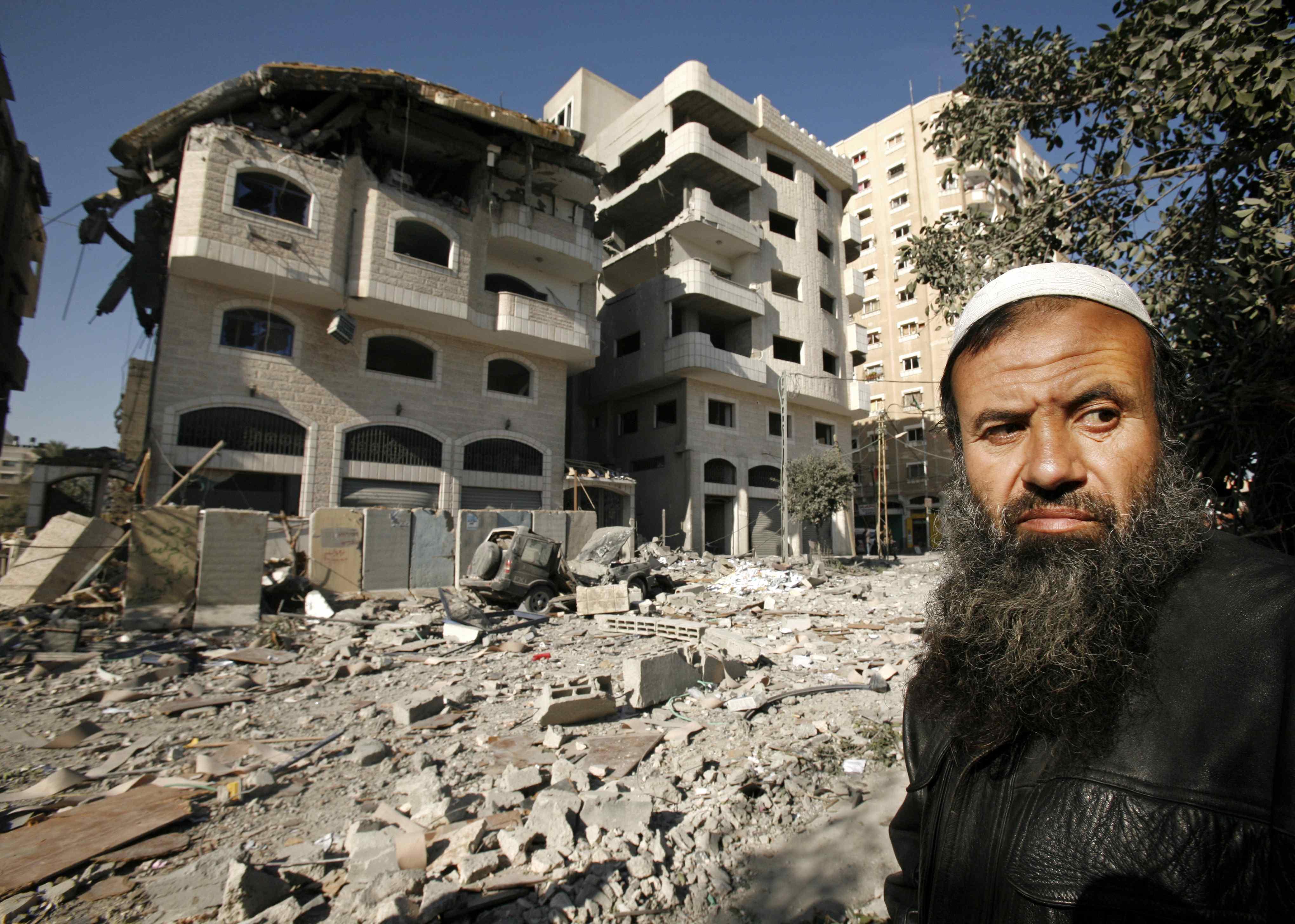 A Palestinian man walks past a destroyed Hamas-run Interior Ministry in Gaza City, Gaza Strip yesterday.