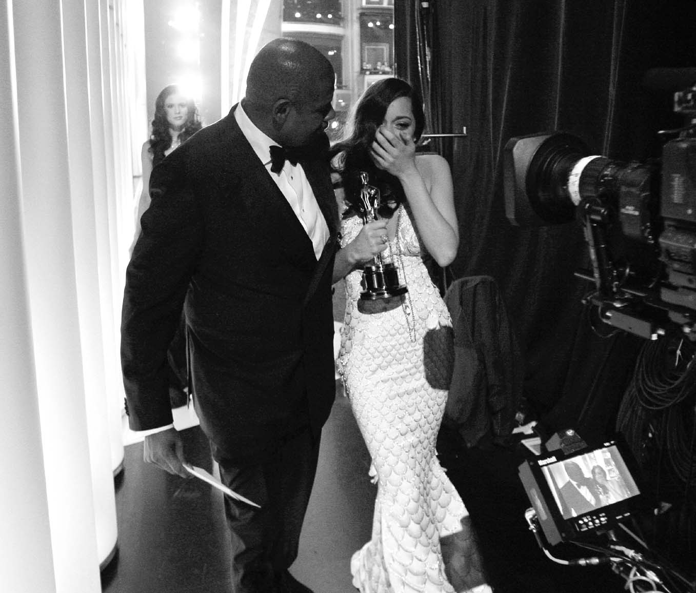 Best Actress winner Marion Cotillard, right, with presenter Forest Whitaker are seen backstage during the 80th annual Academy Awards in Hollywood, Cal...