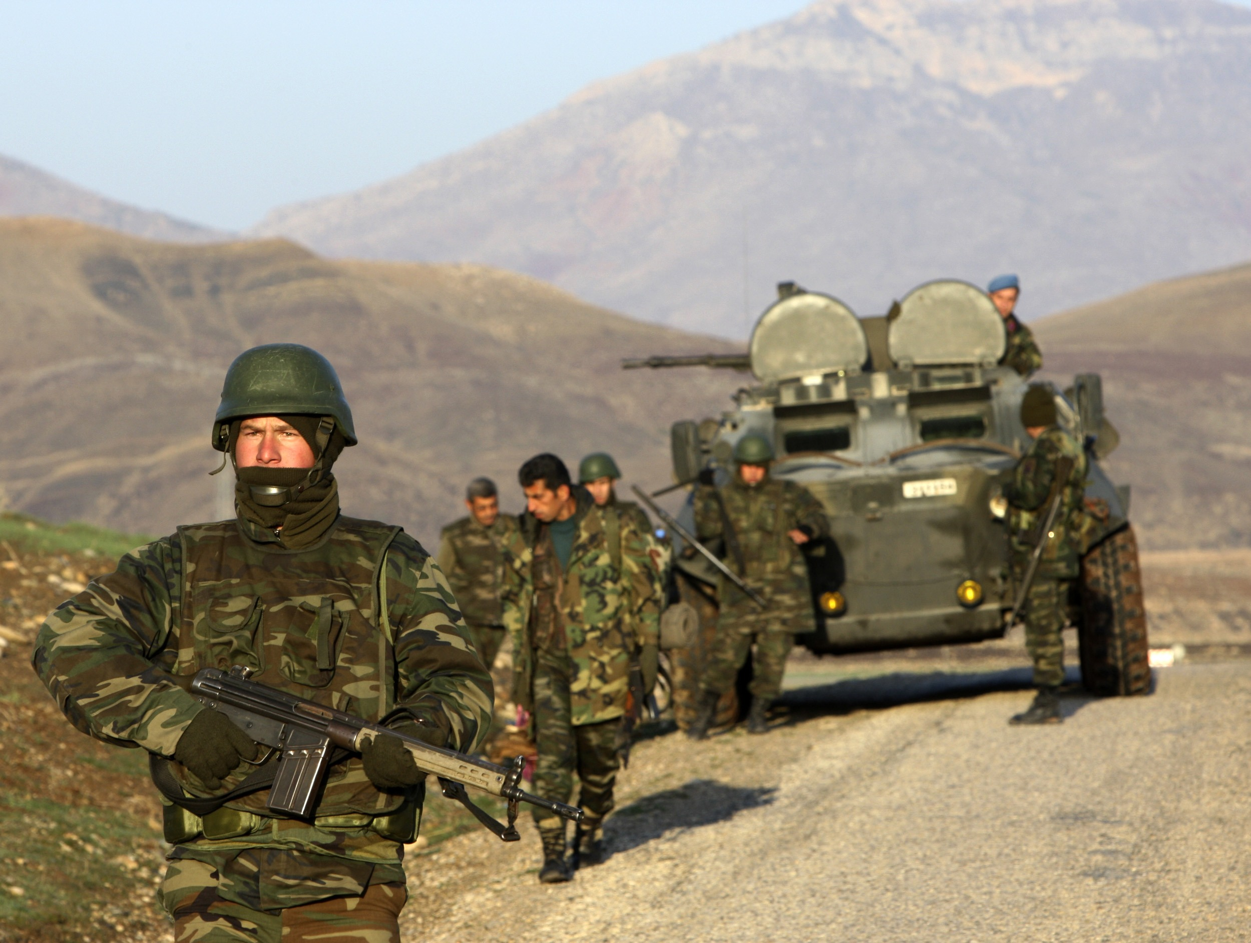 Turkish soldiers search for roadside mines in a rugged area in the Turkish province of Sirnak, bordering Iraq on Thursday.