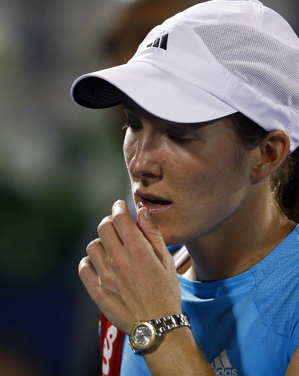 Justine Henin walks from the court after being defeated by Francesca Schiavone at the WTA Dubai Tennis Championships in Dubai, United Arab Emirates on...