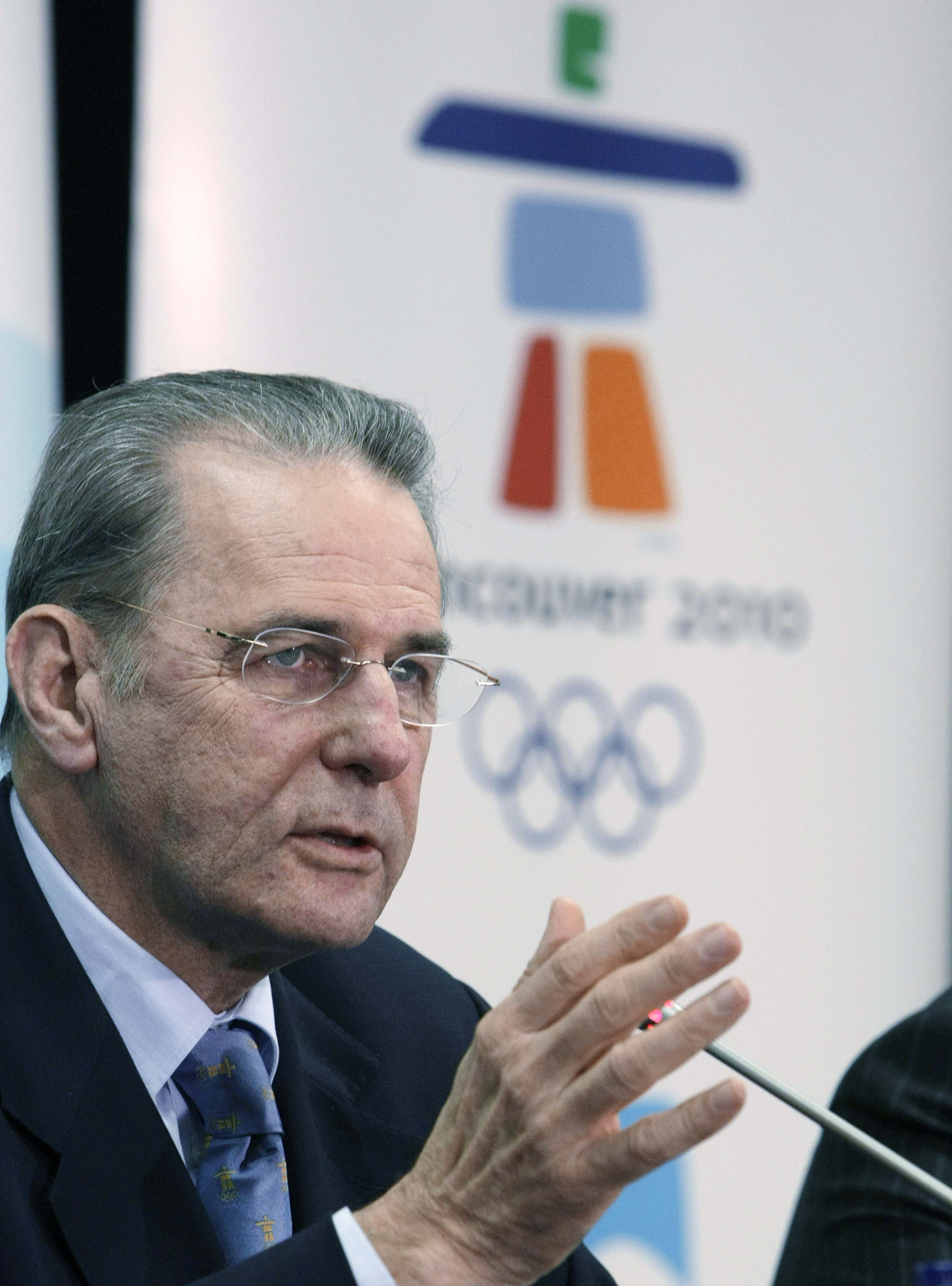 International Olympic Committee President Jacques Rogge answers questions during a news conference in Vancouver, British Columbia on Thursday.