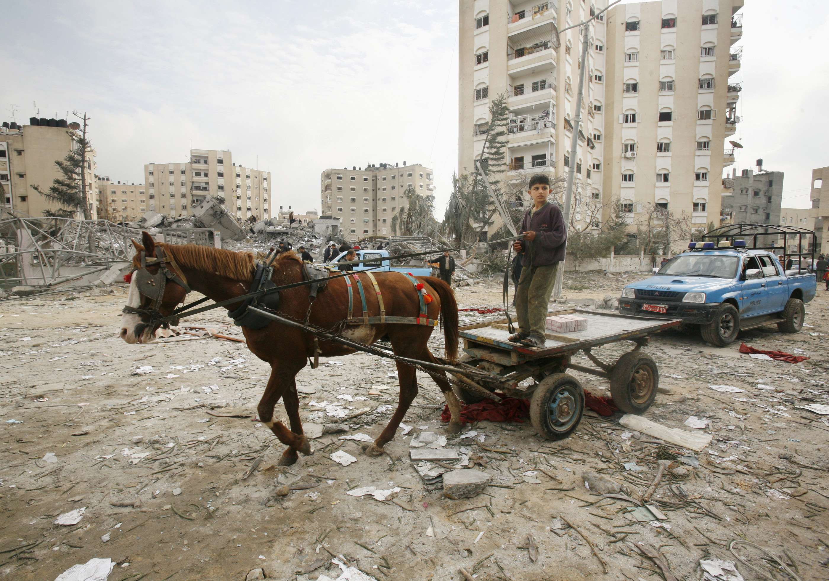 A Palestinian boy rides past the destroyed Workers Union headquarters in Gaza City, Gaza Strip yesterday.