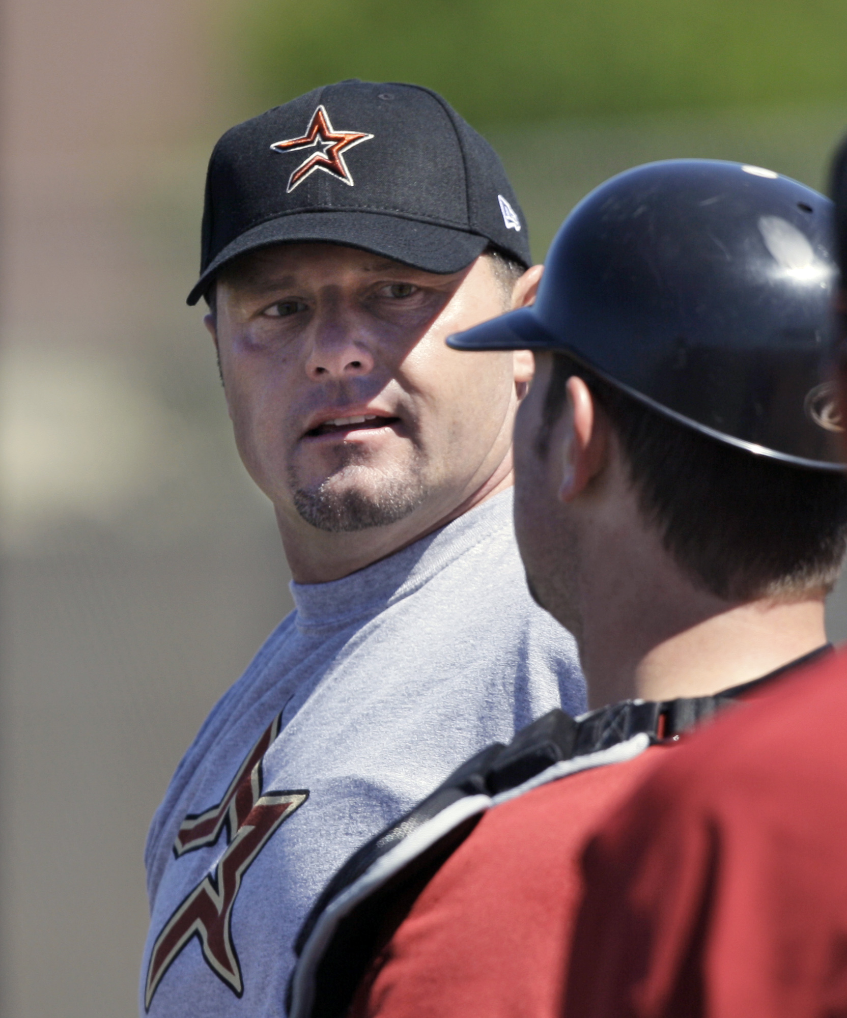 Roger Clemens, left, talks with catcher Max Sapp, right, during a workout with minor leaguers at the Houston Astros spring training facility in Kissim...