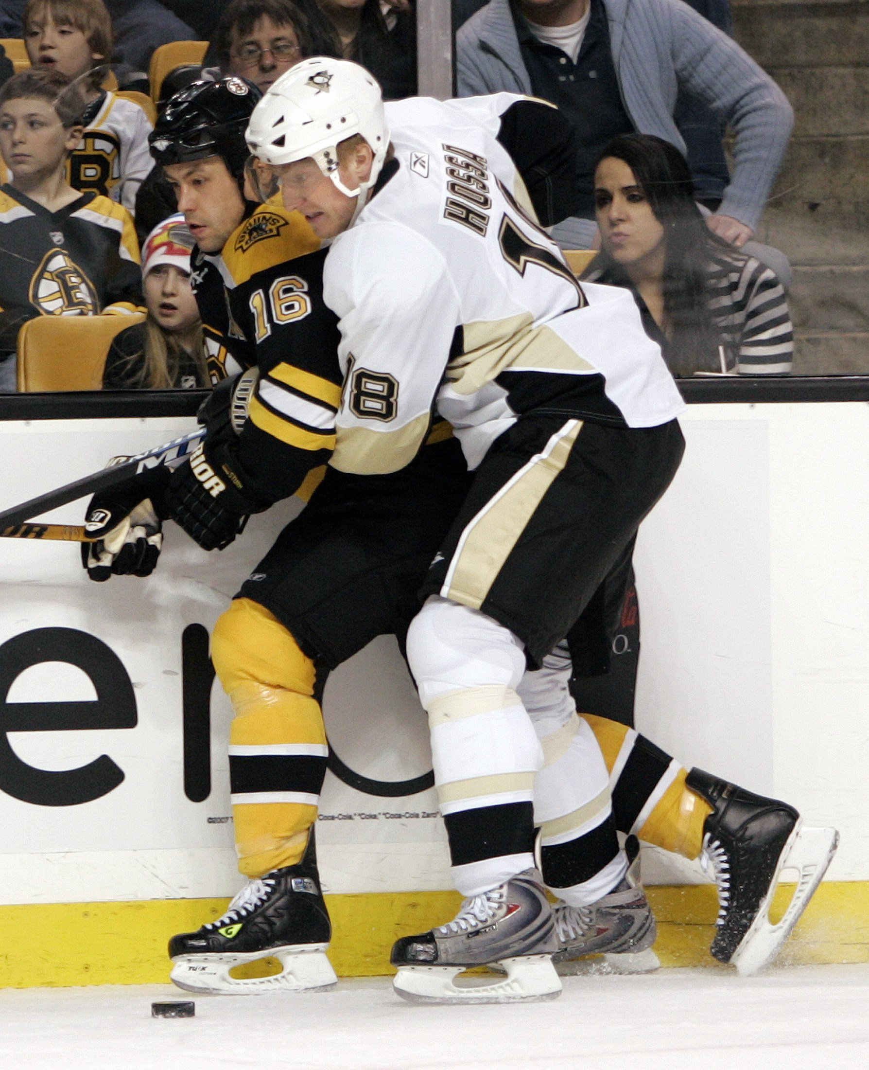 Pittsburgh Penguins' Marian Hossa, right, fights for the puck with Boston Bruins' Marco Sturm during NHL hockey action in Boston, Massachusetts on Thu...