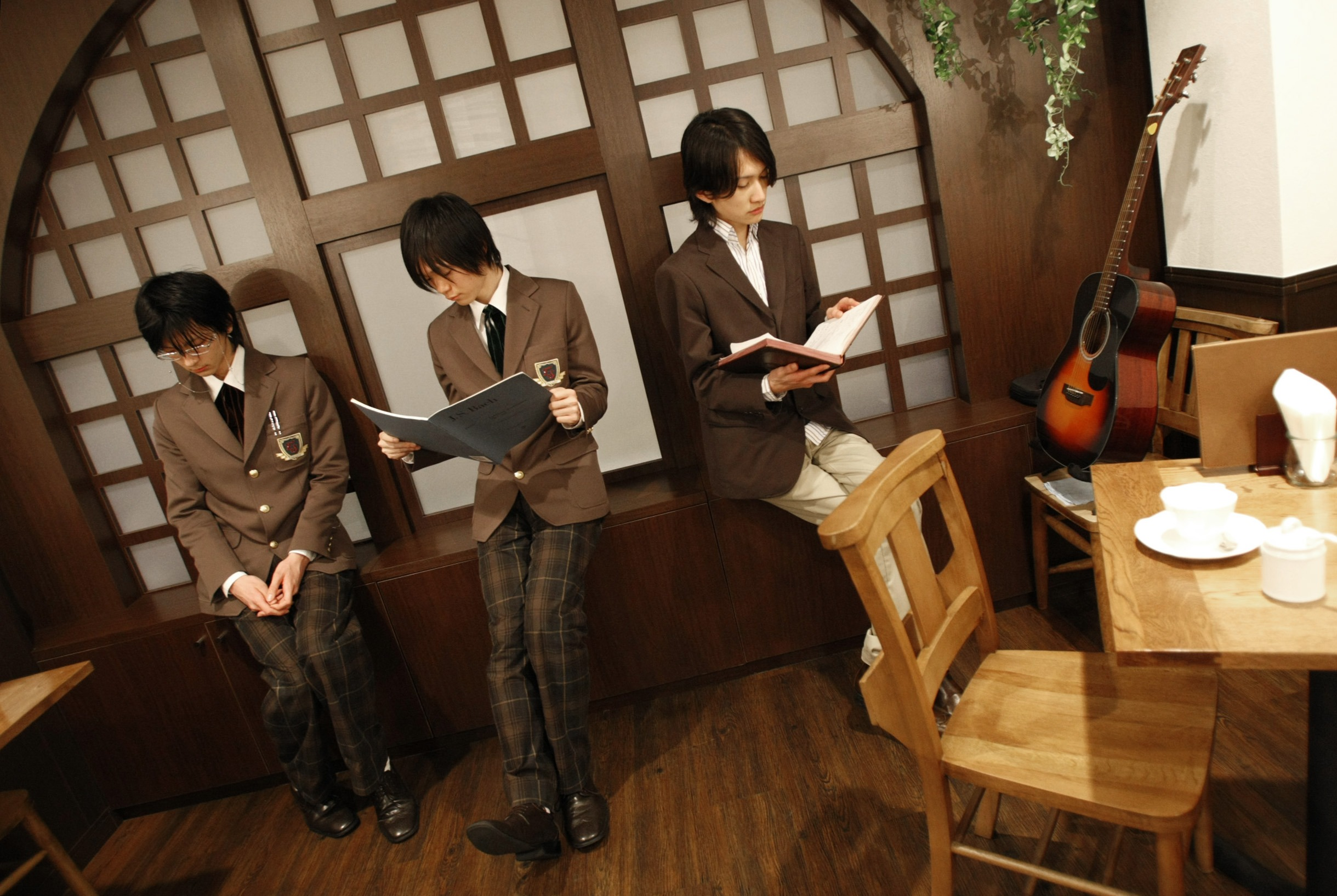 Left to right: Waiters Ritsuki Sunomiy, Yuta Asami and Makoto Aoba, dressed in costumes, pose at Edelstein cafe in Tokyo, Japan, yesterday.