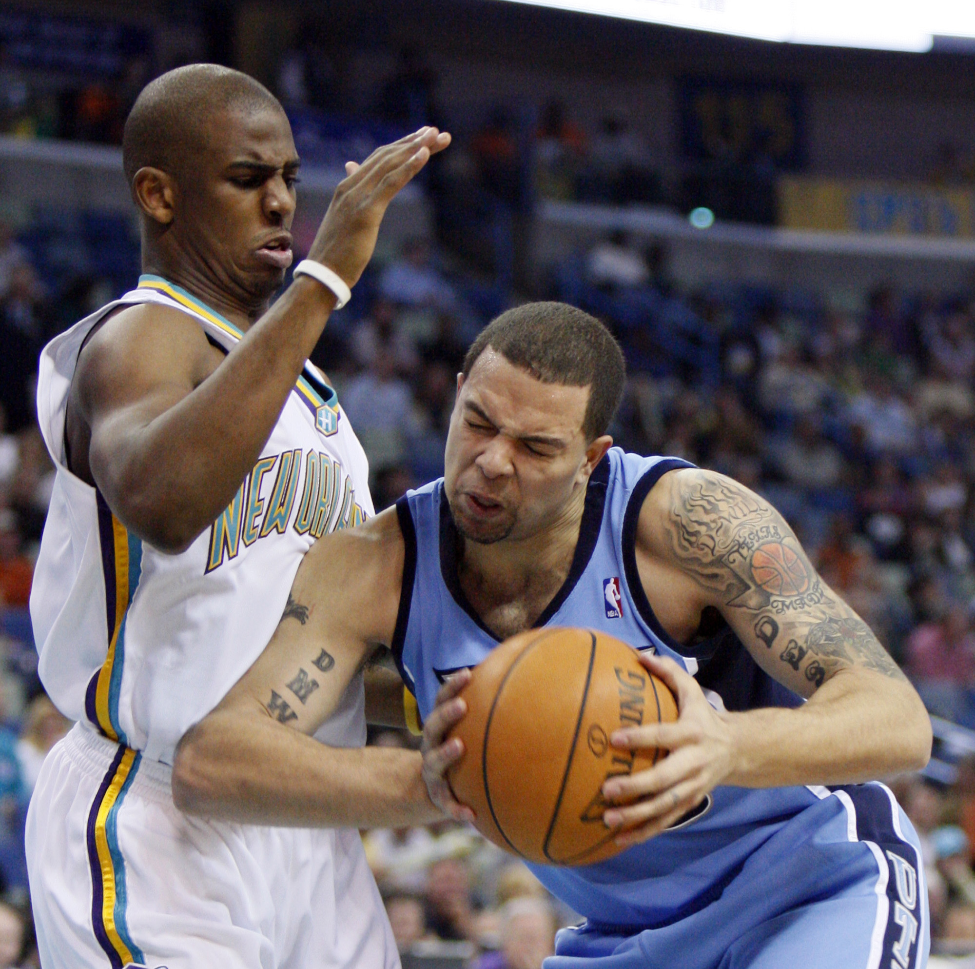 New Orleans Hornets' Chris Paul, left, guards Utah Jazz's Deron Williams in the first half of their NBA basketball game in New Orleans, Louisiana on F...
