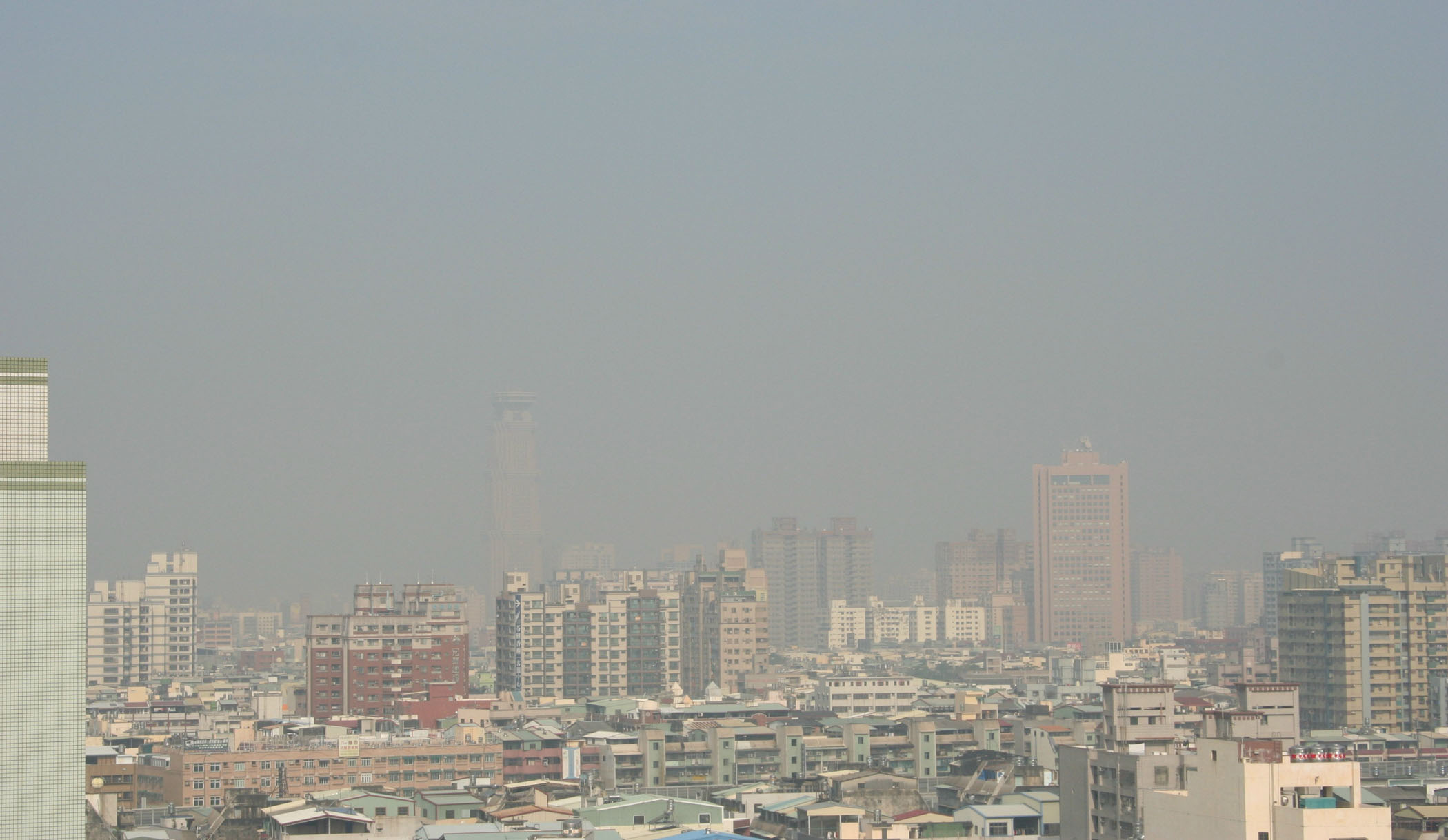 The skyline of the southern port city of Kaohsiung is shown shrouded in dust yesterday amid the onslaught of a dust storm from China.