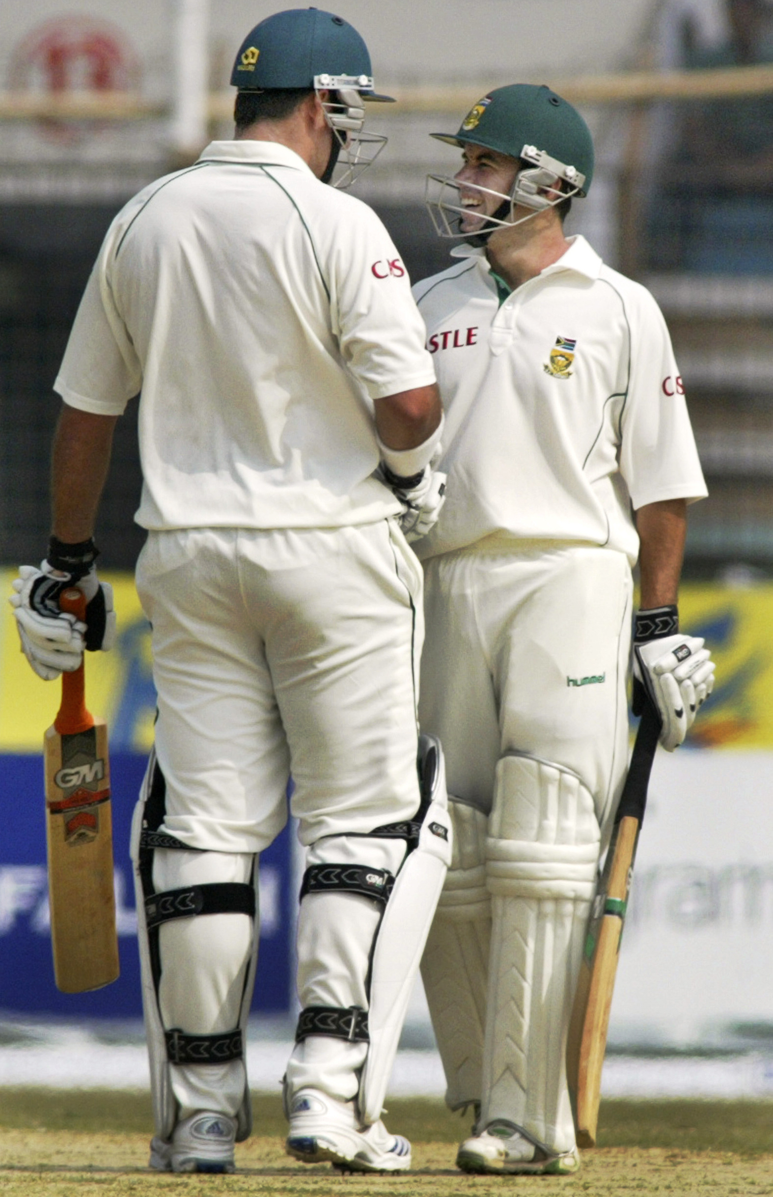South Africa's Graeme Smith and Neil McKenzie, right, congratulate each other after setting a world record in opening partnership during their second ...