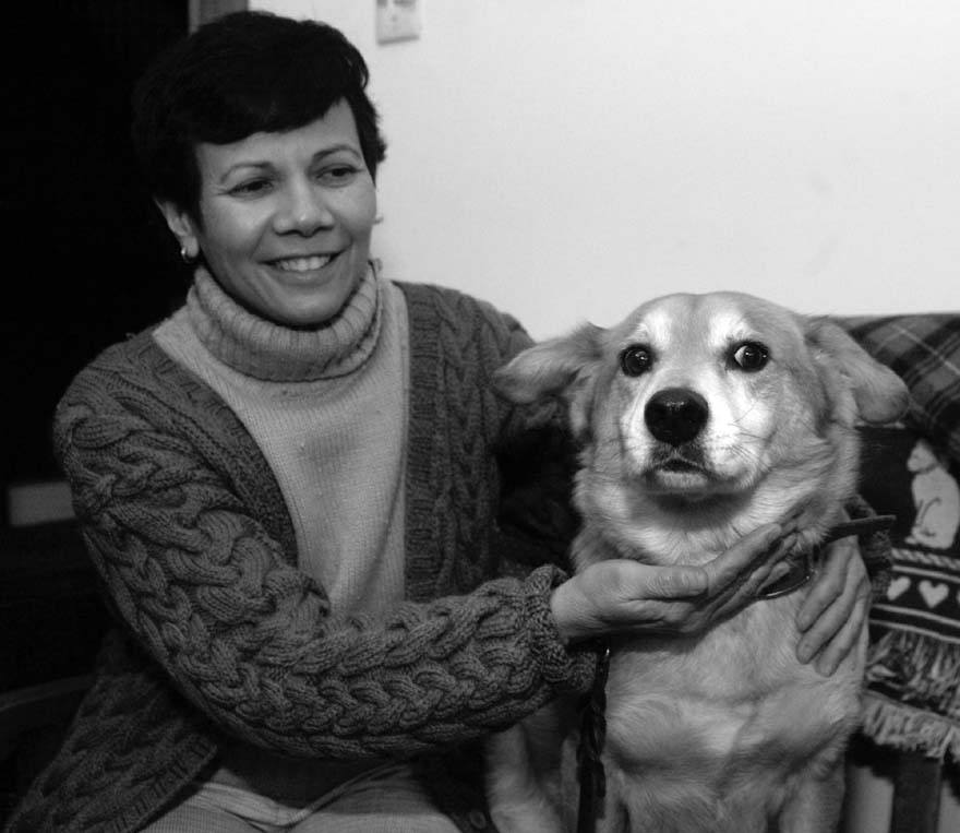 Marian Banks is seen sitting with her dog, Sparky, at her home in St. Louis, Missouri, in this January 2006 file photo.
