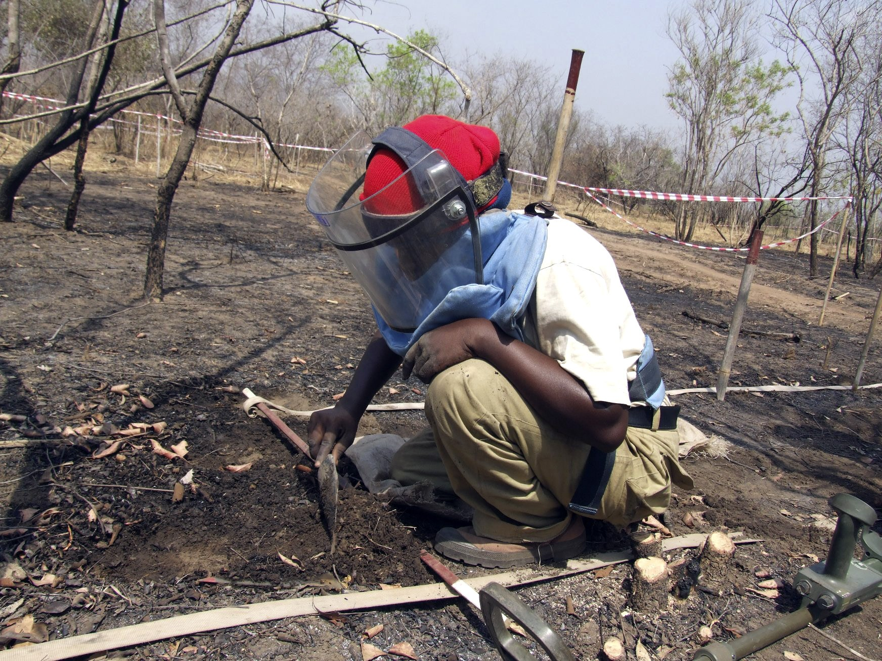 Joanne Jenty, a deminer, searches for mines on the Mile 38 battlefield, 38 miles from the southern Sudanese capital of Juba, in February.