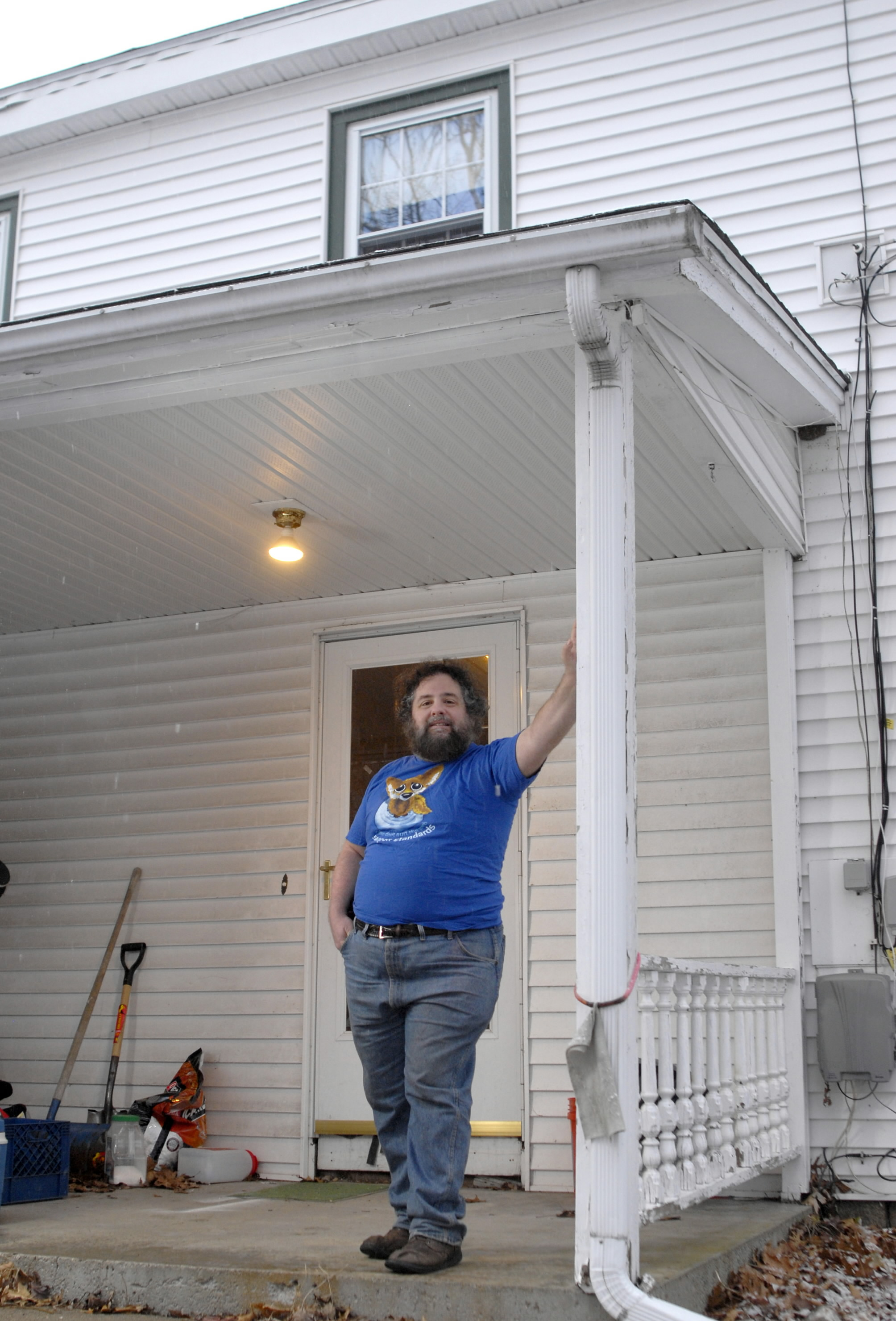 Author James Turner stands in front of his 1796 farmhouse in Derry, New Hampshire. Turner insulated his home with polyurethane hard cell insulation th...