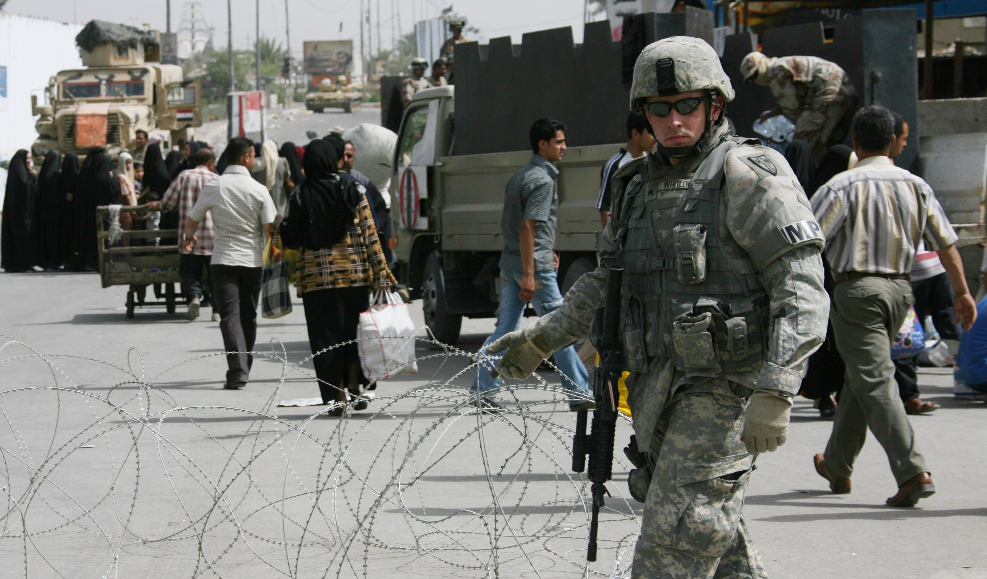 U.S. Army's soldier secures a checkpoint in the Shiite enclave of Sadr City Baghdad, Monday. Due to a violence that broke out on Sunday families where...