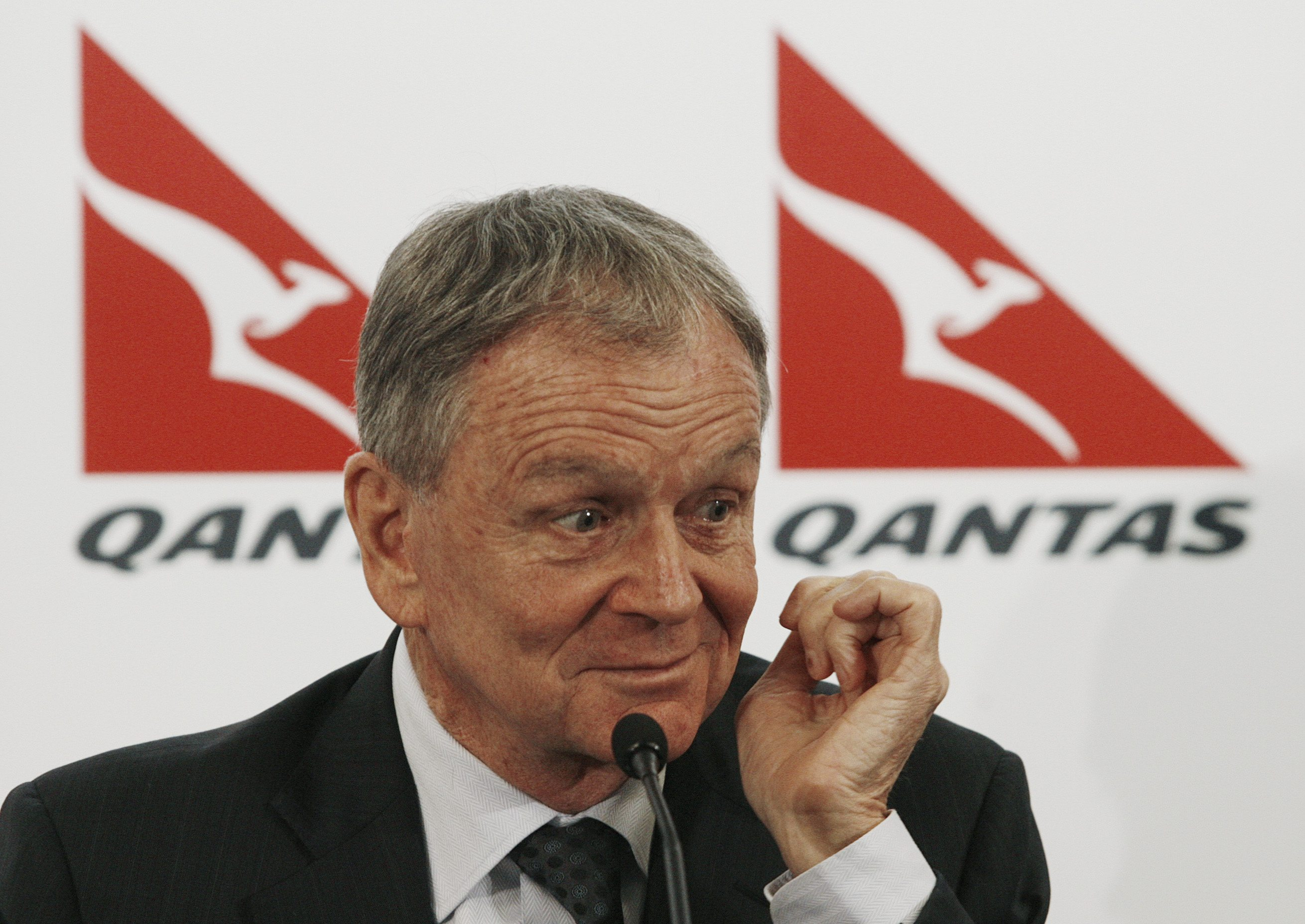 Retiring Qantas Chief Executive Officer Geoff Dixon gestures during a news conference in central Sydney, Australia yesterday.