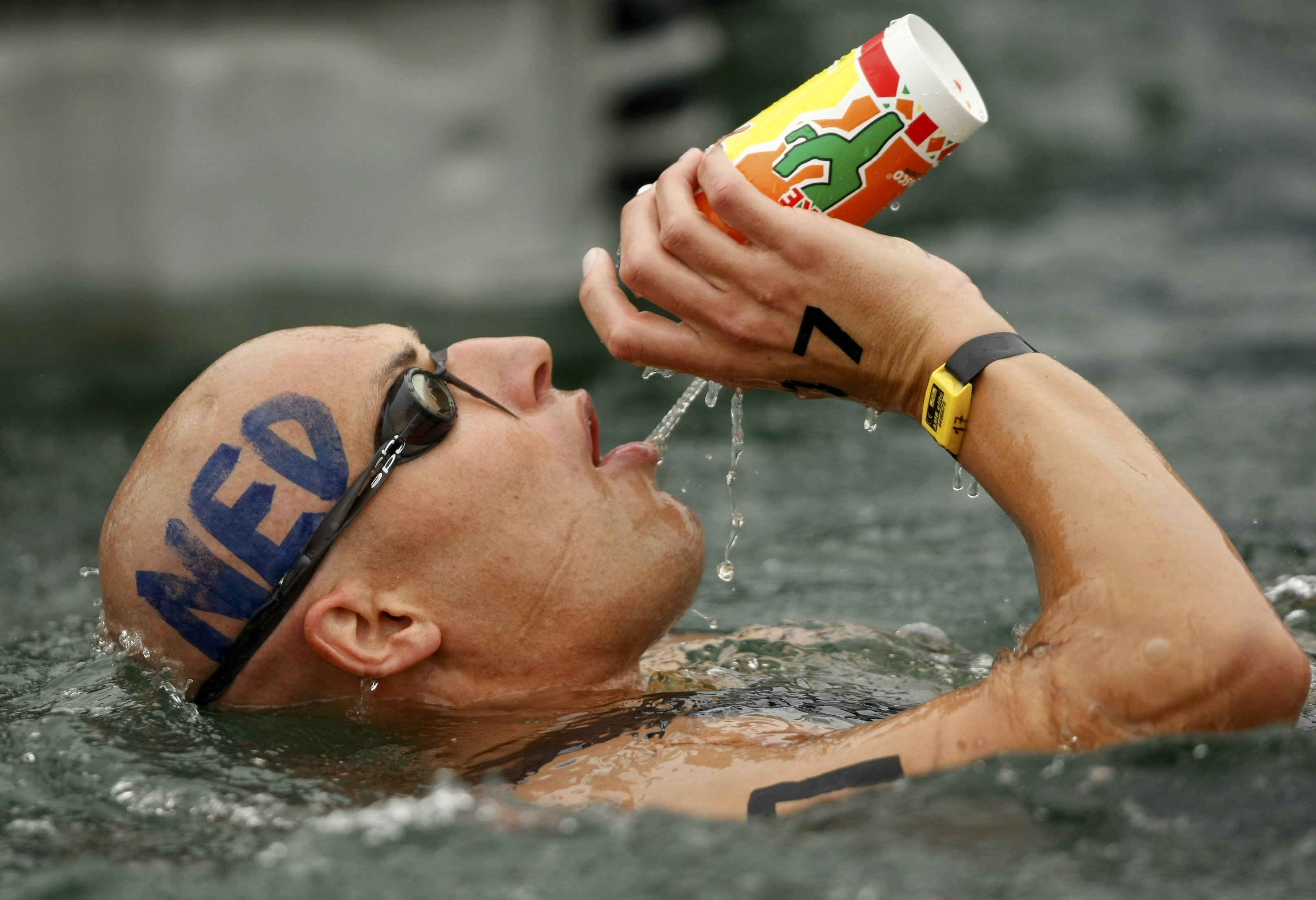 Maarten van der Weijden of the Netherlands drinks while competing in the men's marathon 10km swimming event at the Beijing 2008 Olympic Games in China...