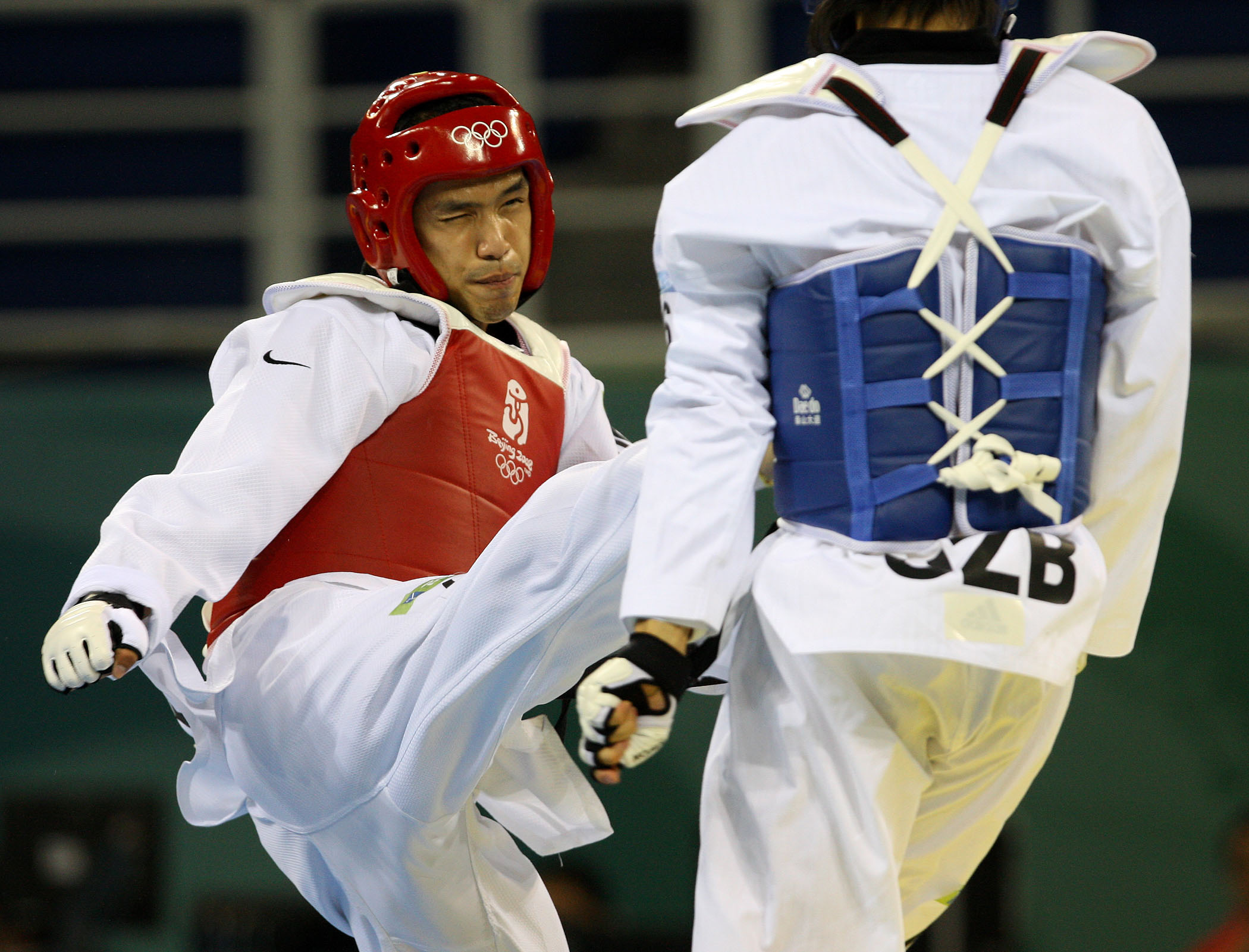 Sung Yu-chi, left, defeats his rival to win a fourth bronze for Taiwan at the 2008 Beijing Olympics.