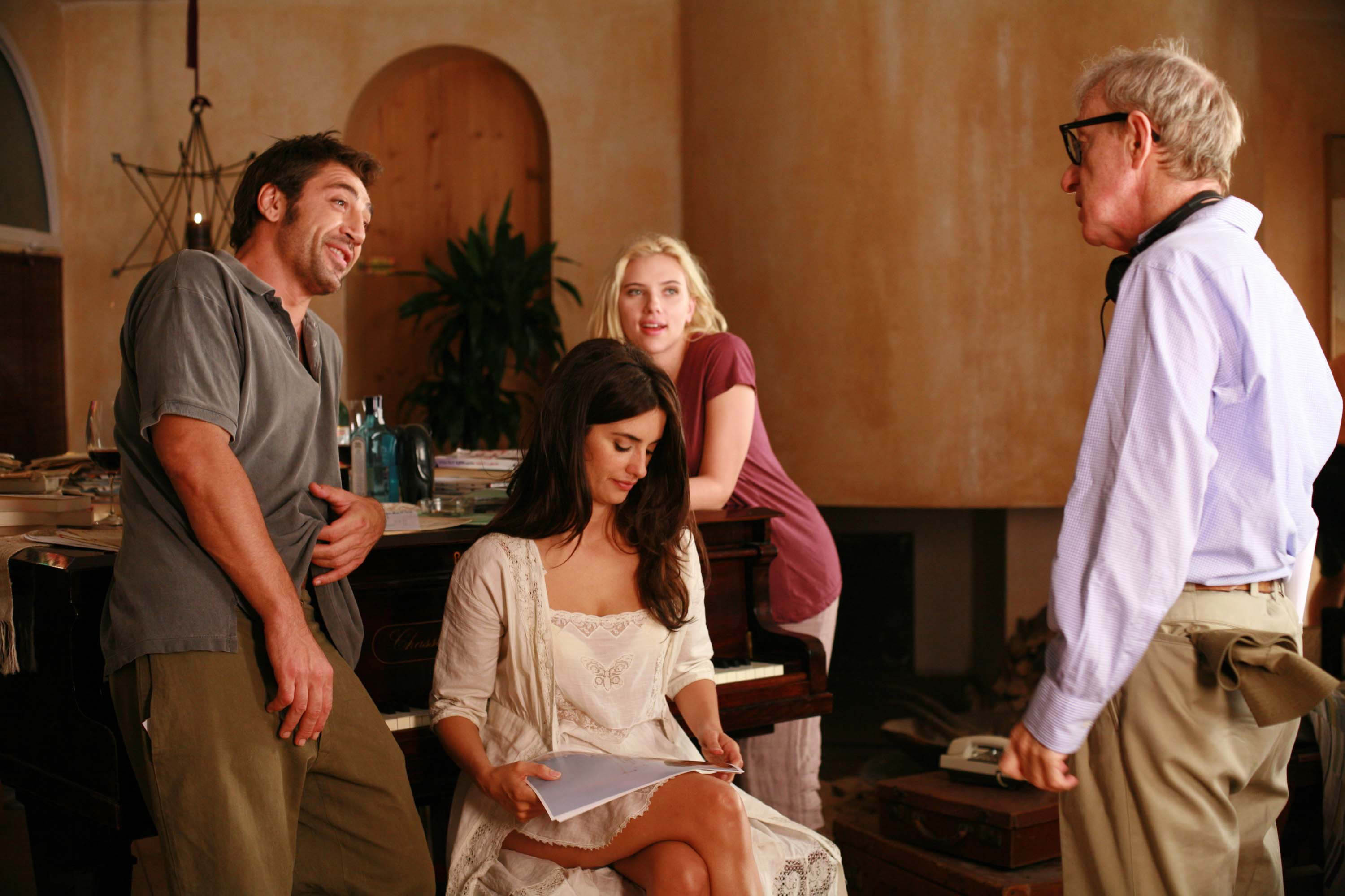 Director Woody Allen, right, is seen speaking to actors, from left, Javier Bardem, Penelope Cruz, and Scarlett Johansson on the set of 'Vicky Cristina...